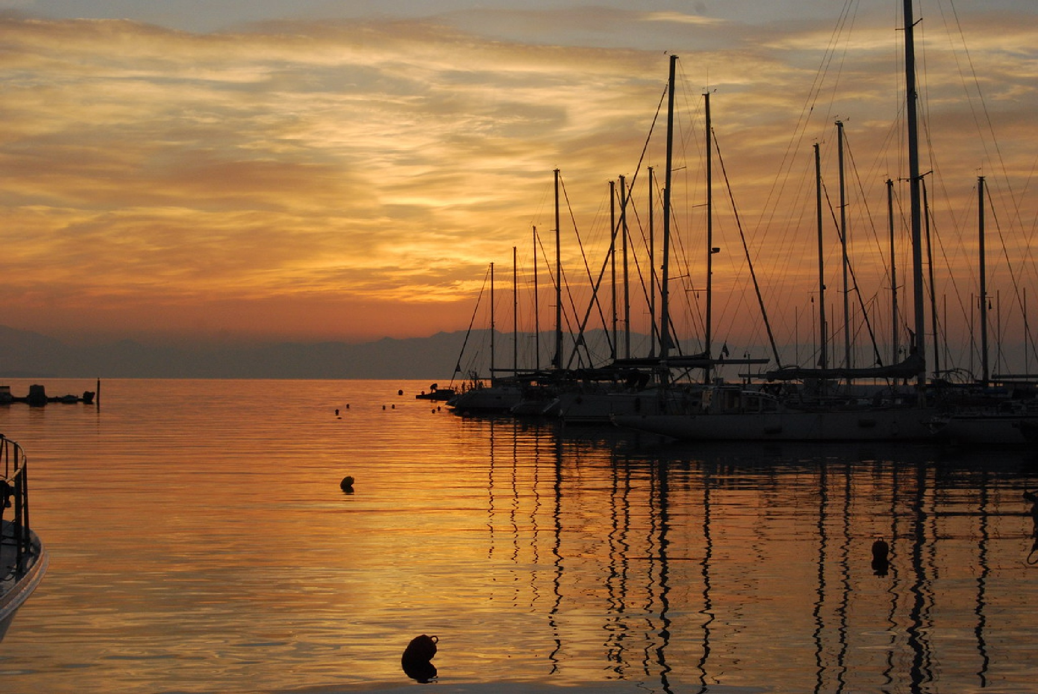 harbor at sunset by Lampros Ntoulas
