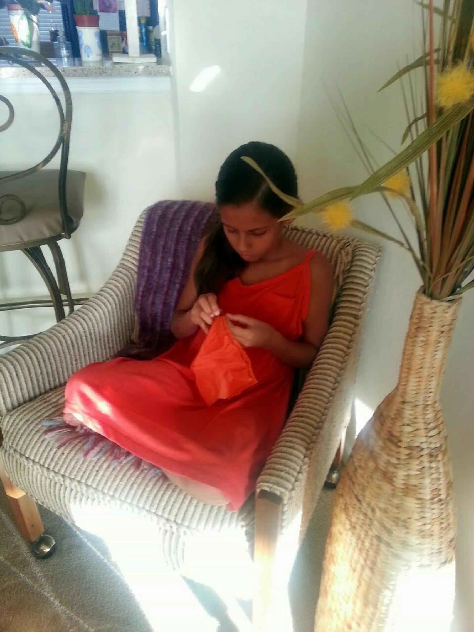 Granddaughter learning how to sew. by aida.carpena