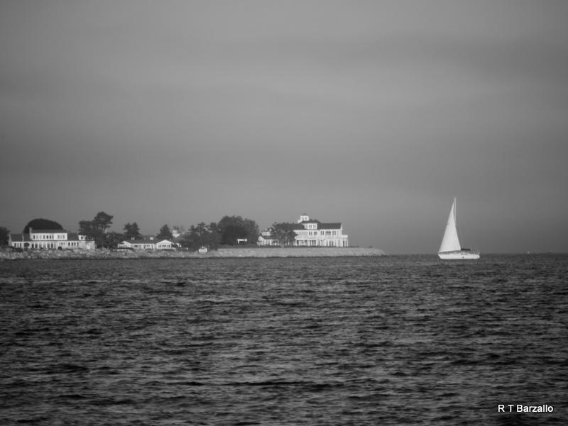 Sailboat Hugging the Coast by Robert_Barzallo