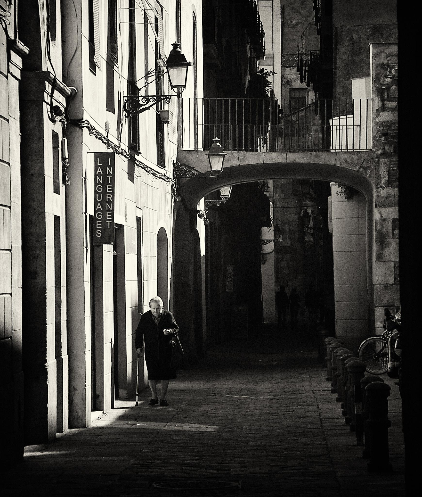 Photo in Street Photography #lady #woman #cane #old #alley #barelona #street