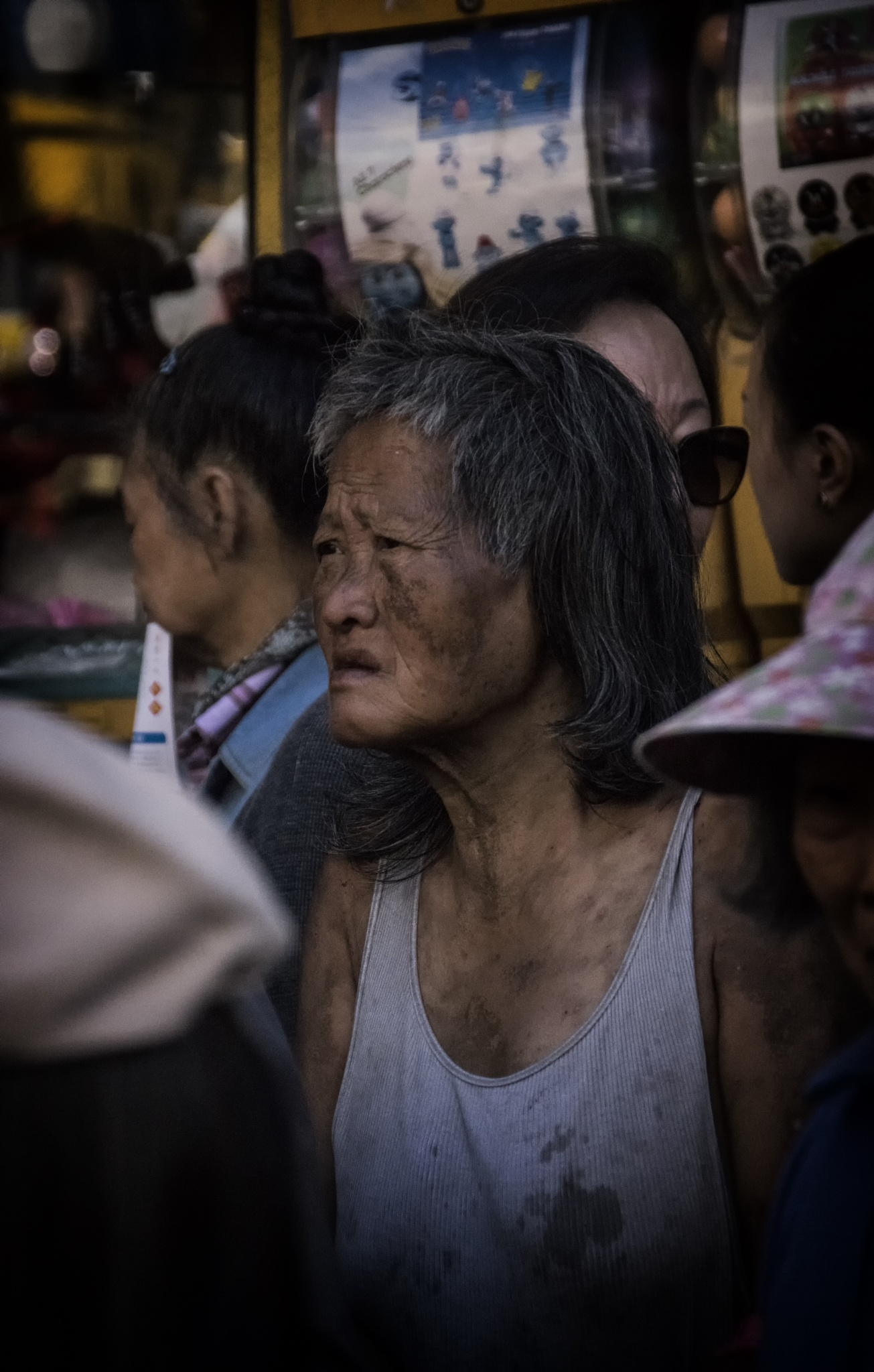 Woman in the crowd in Chinatown by patric.carver