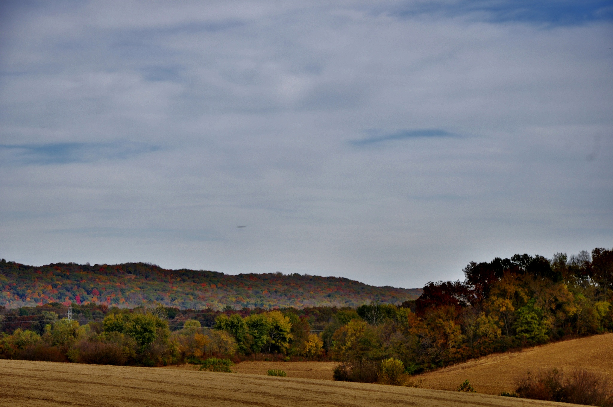 Fields surrounded by bluffs by debbylesko