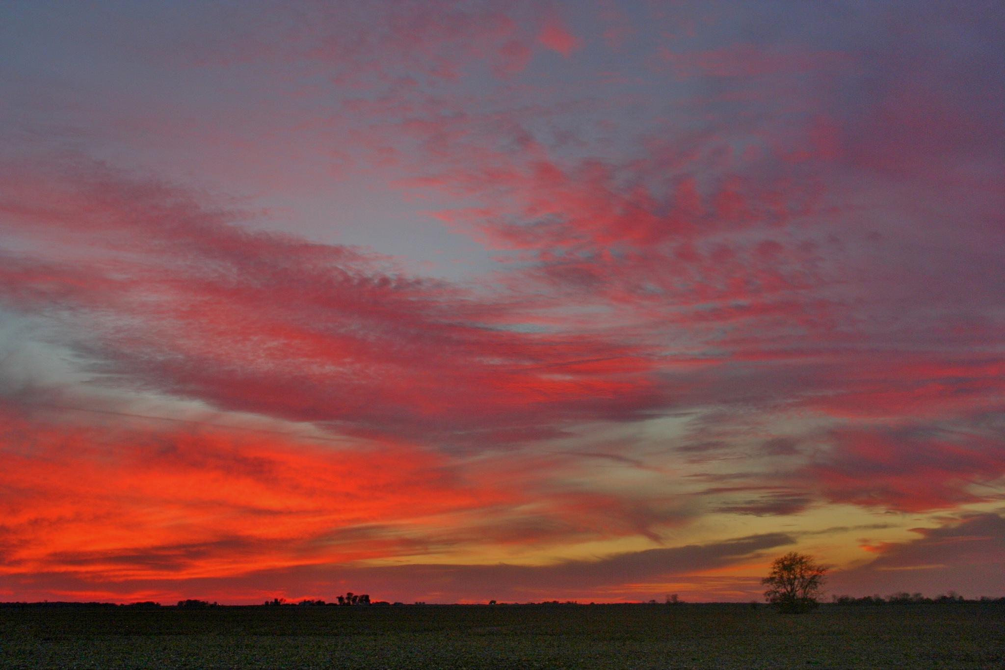 Sunset begins at the river. by debbylesko