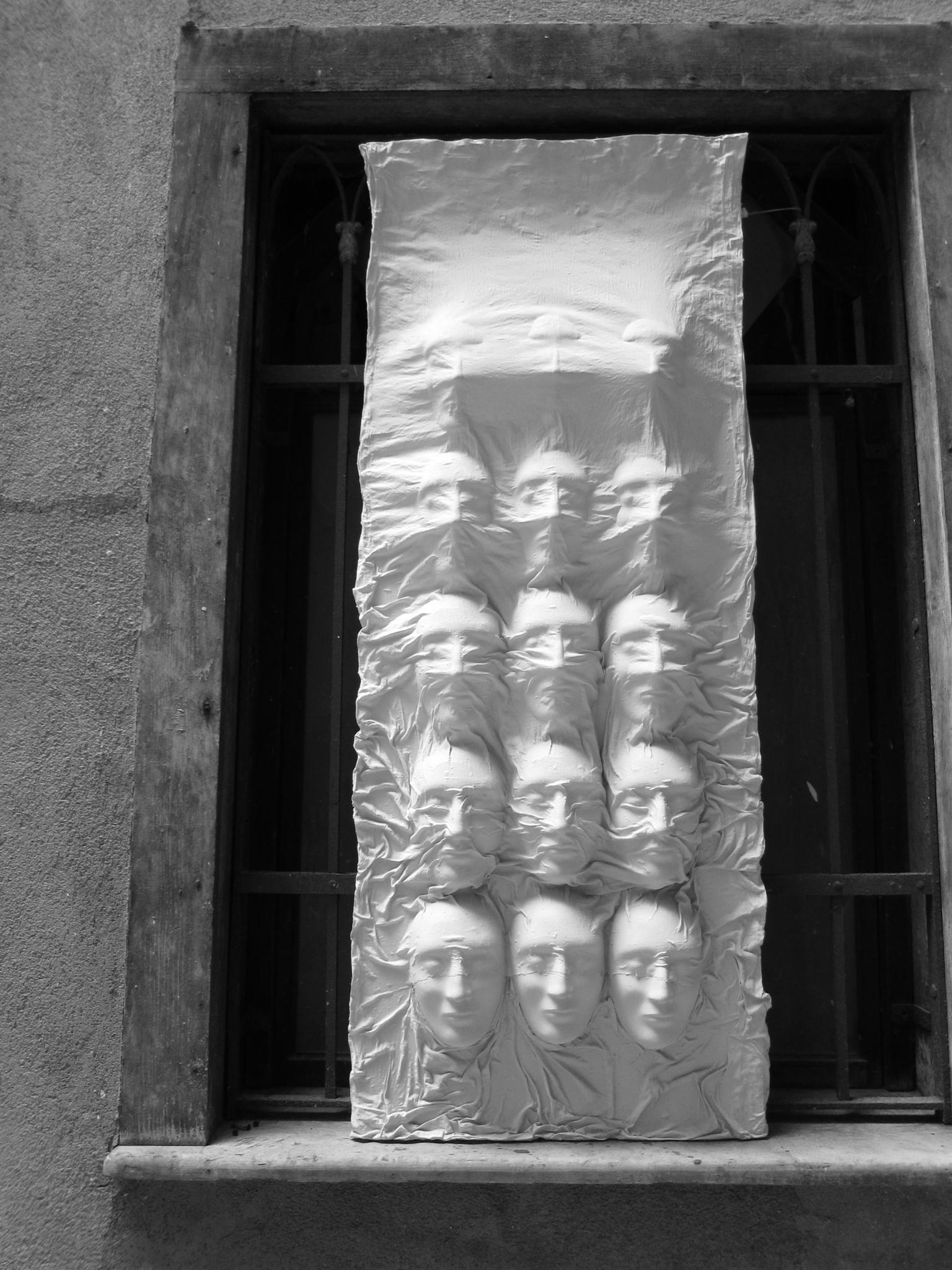 Faces in the window by Carolyn Chase