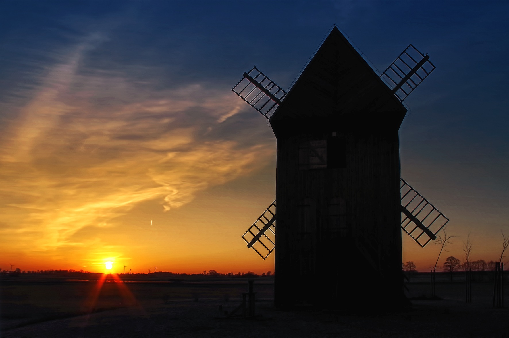 evening landscape with windmill by Tomasz Marciniak
