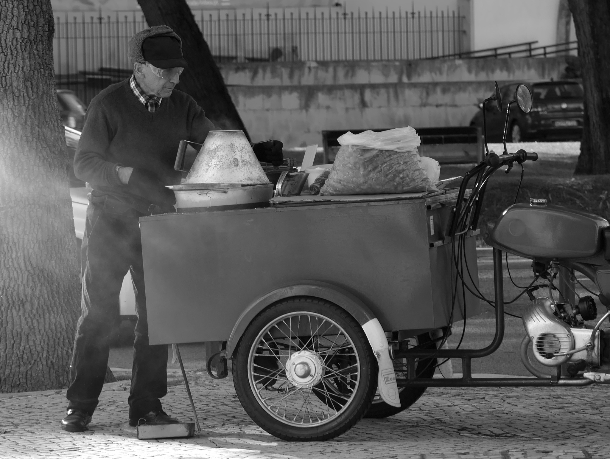 The seller of roasted chestnuts.  by Photosniper