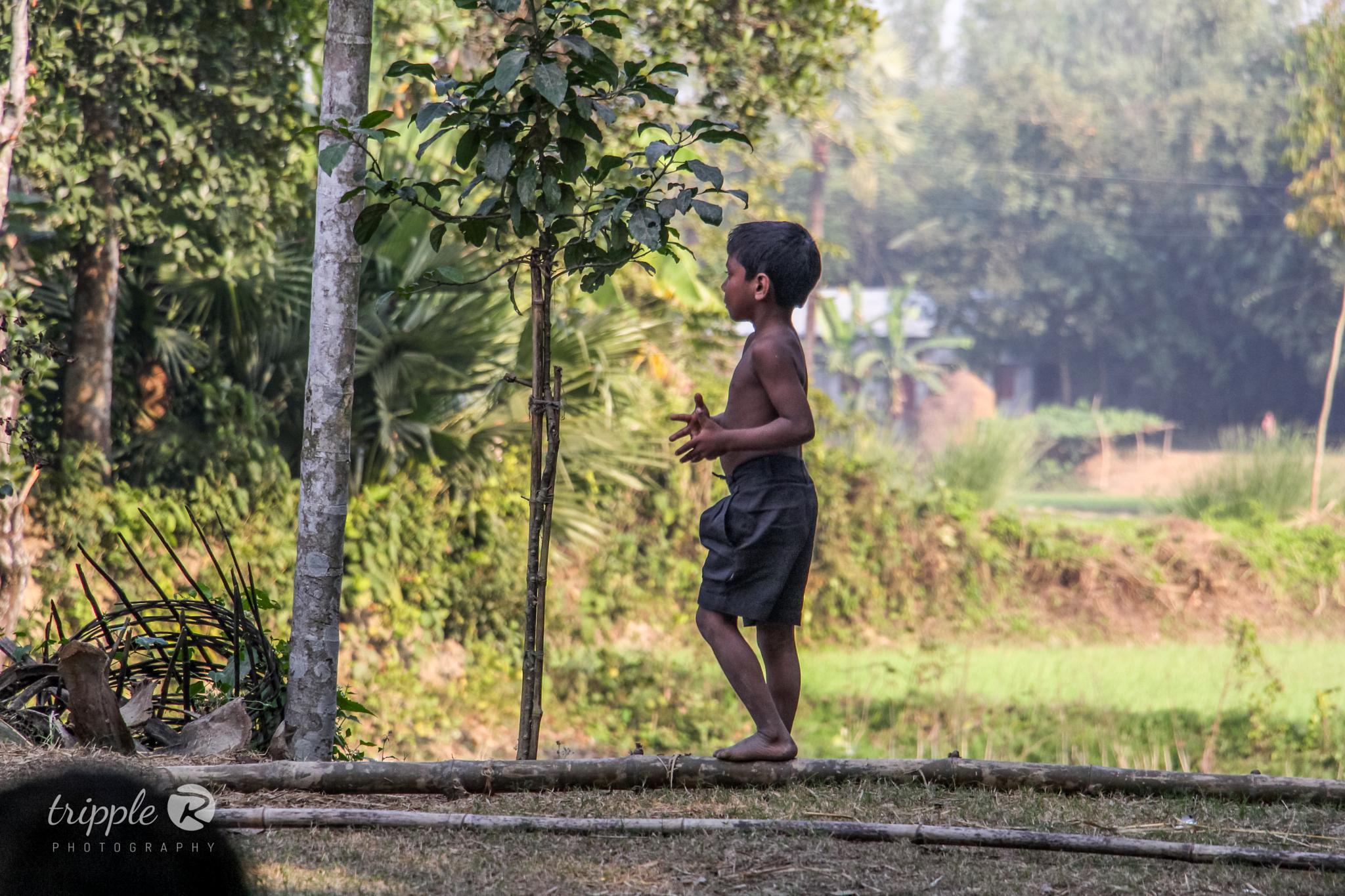A village child by Razeeb Robert Rozario