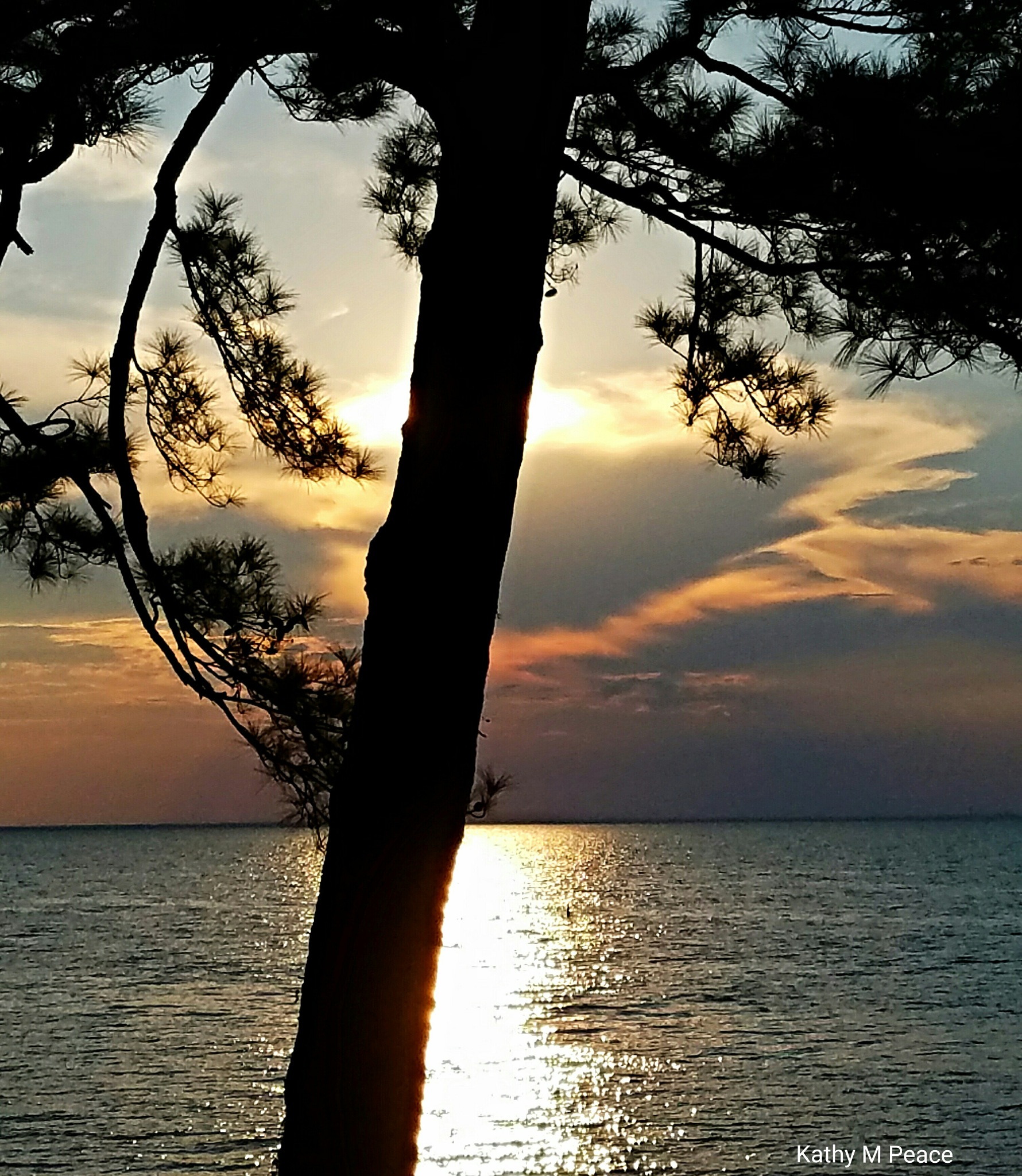 serene sunset over Mobile Bay by kathy.peace.3
