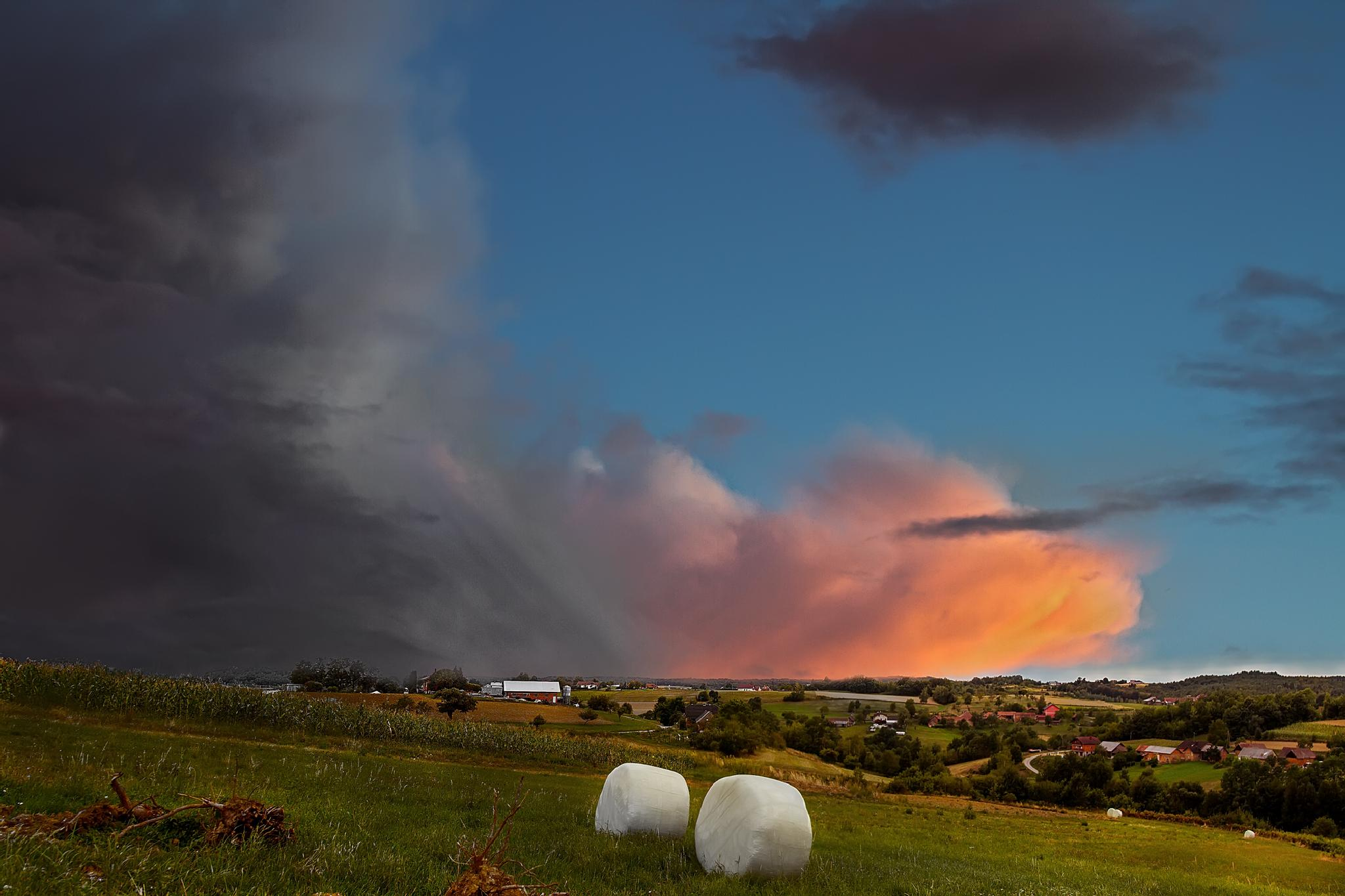 Incoming storm over a small village by zdravko.horvat