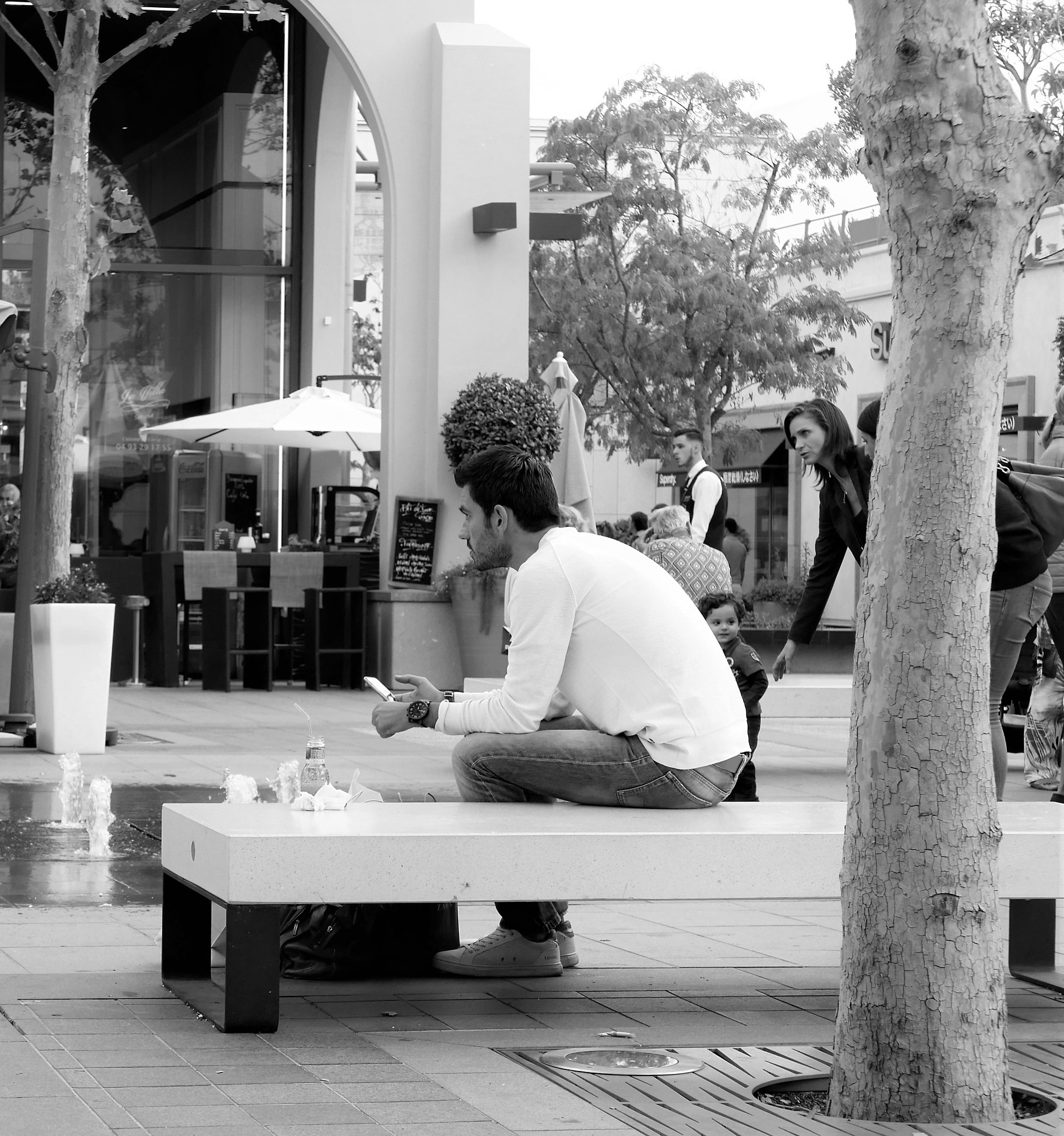 Texting. Polygone Riviera, Shopping Centre by tony cullen