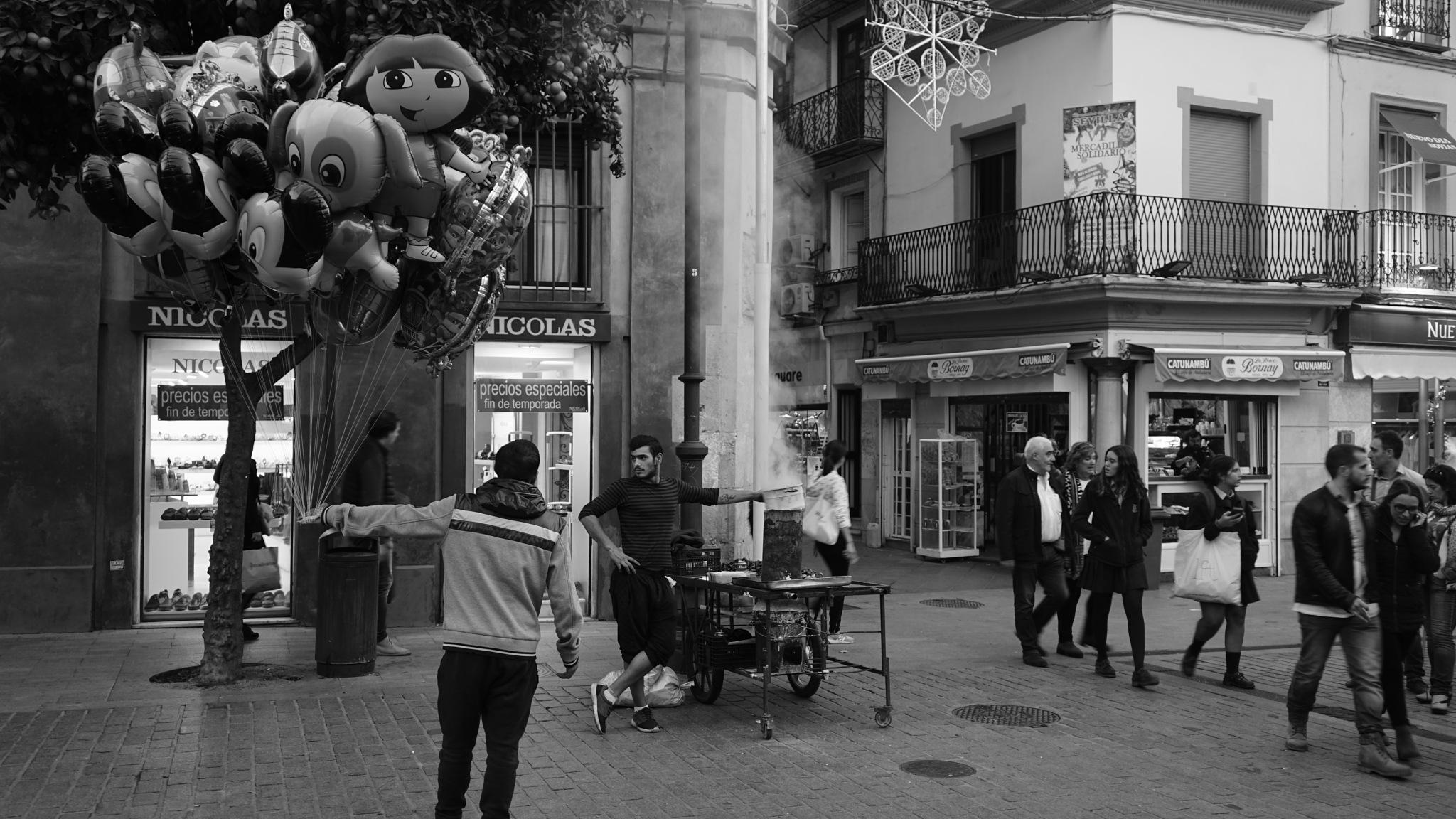 Balloon Seller and Chestnut Roaster arguing, Plaza del Salvador, Seville (Sevilla) by tony cullen