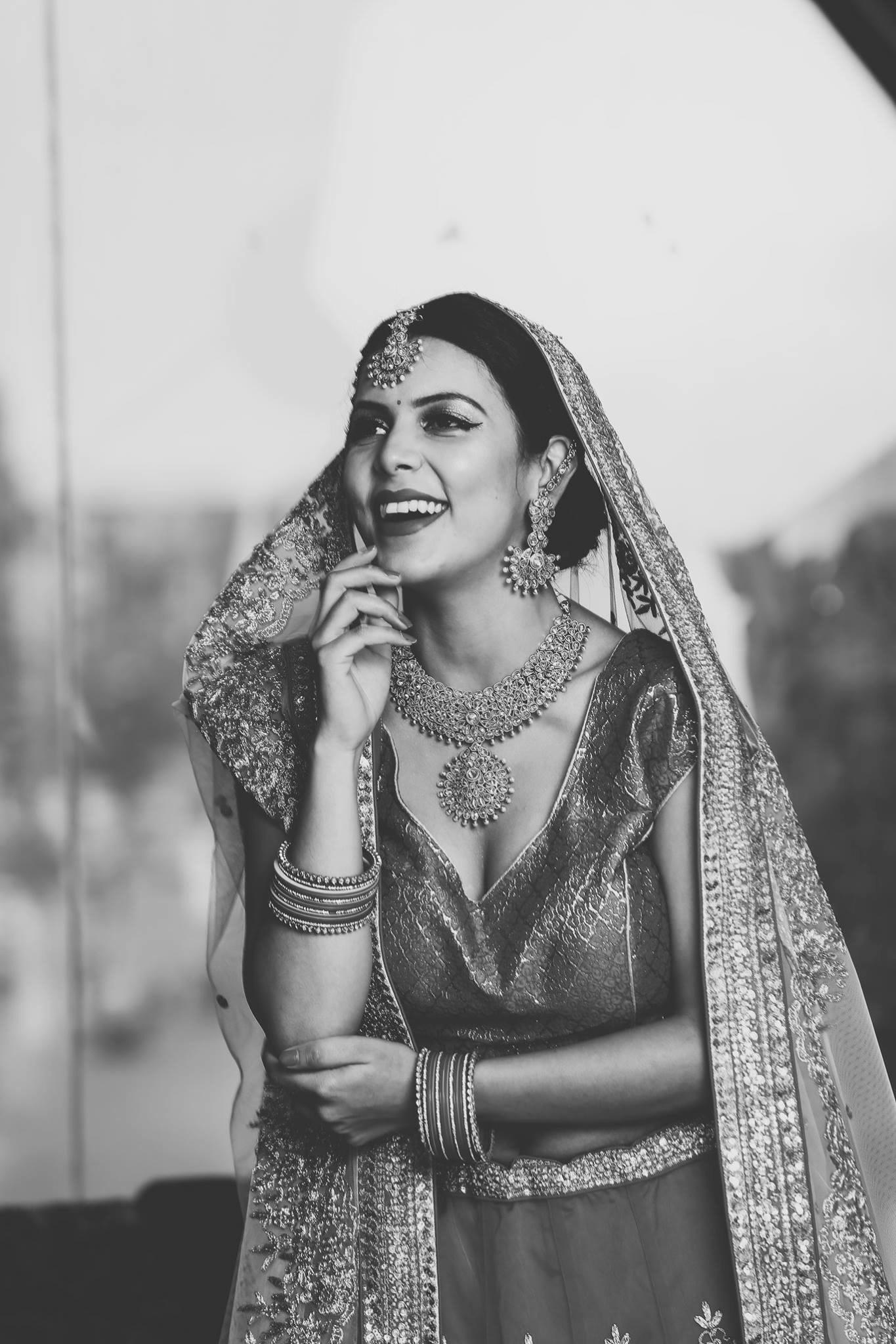 Happy bride  by Amit Batra
