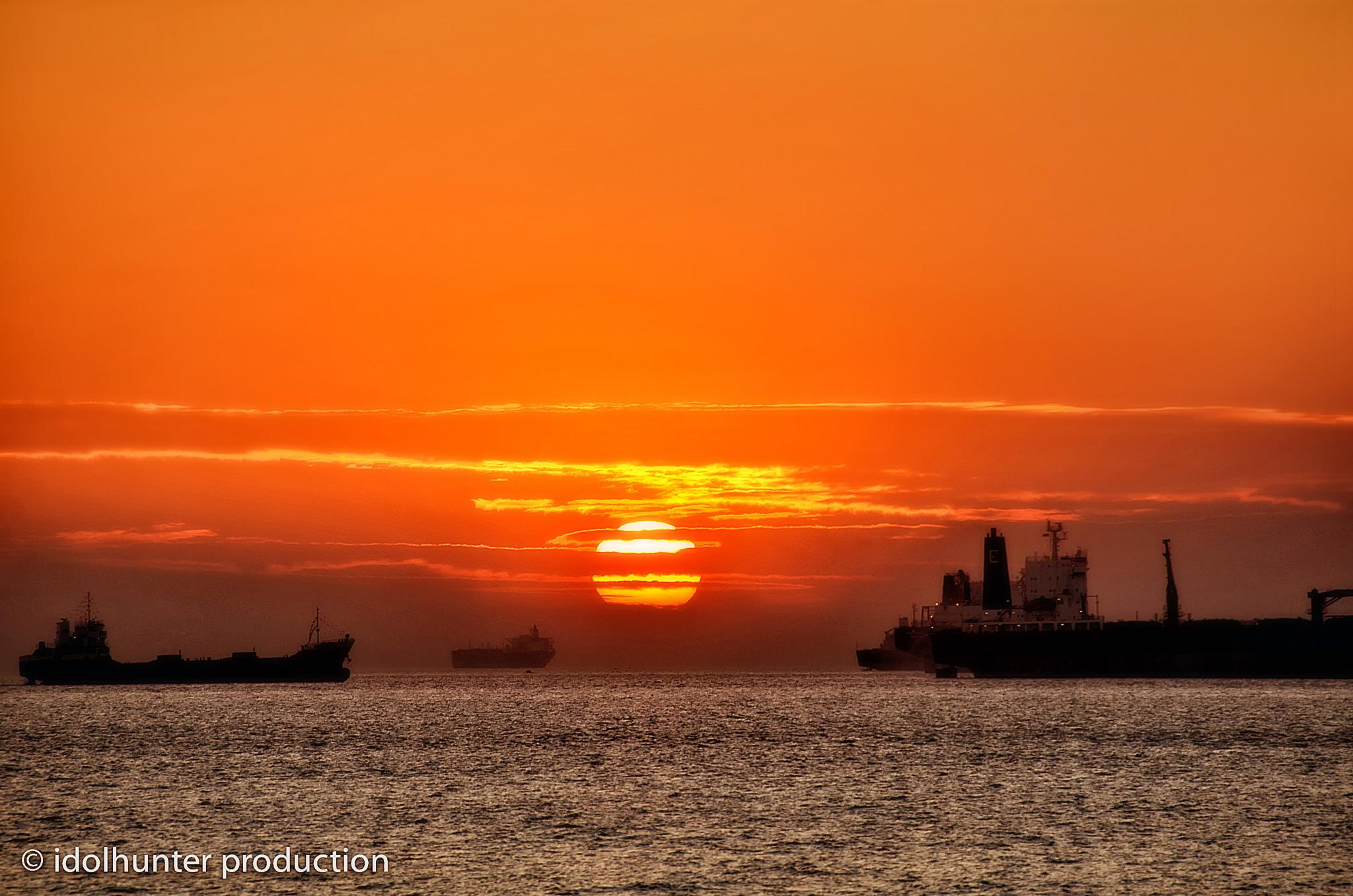 Sunset over Chittagong port. by idolhunter