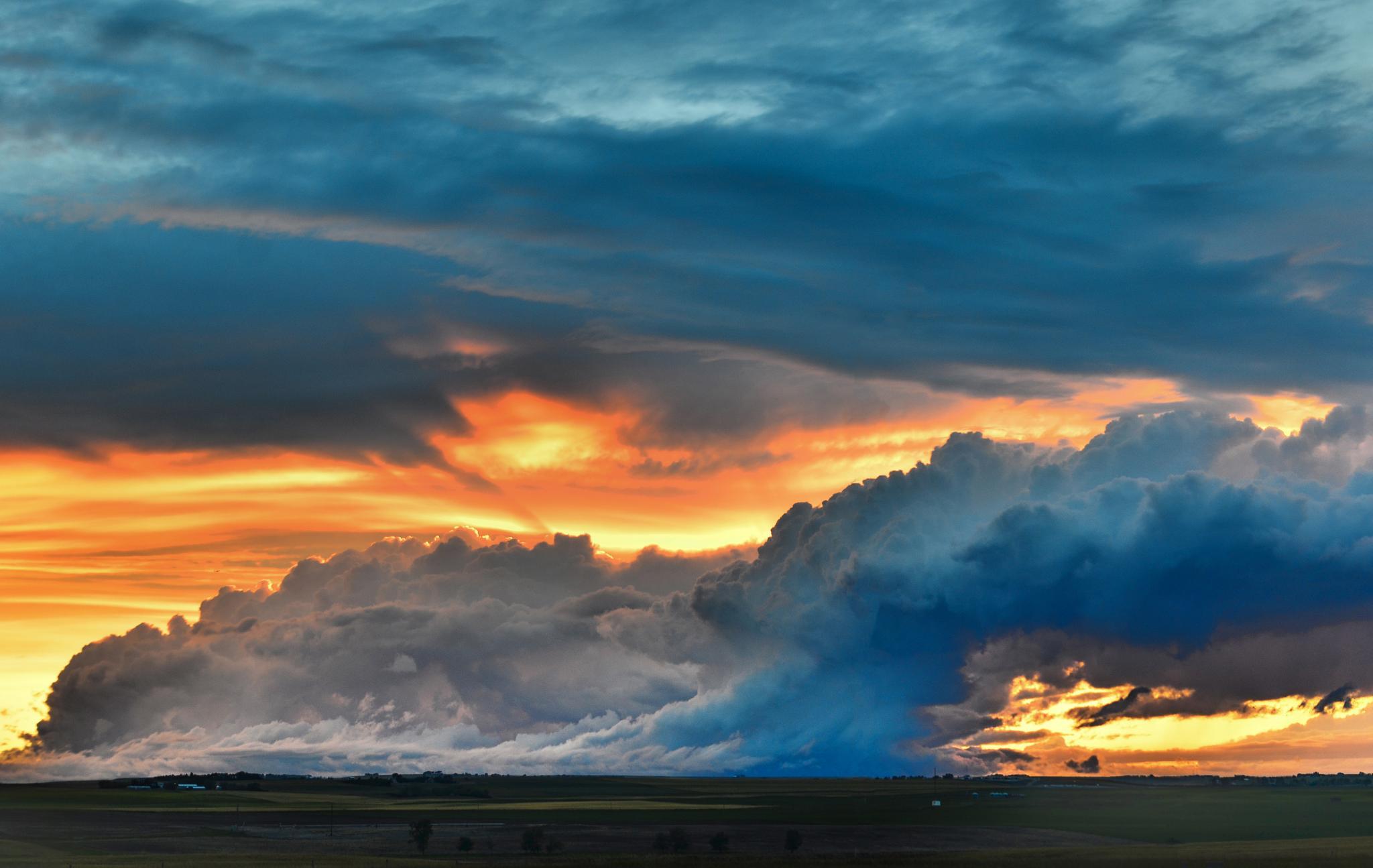 Evening prairie sky, storm coming. by Merle Layden