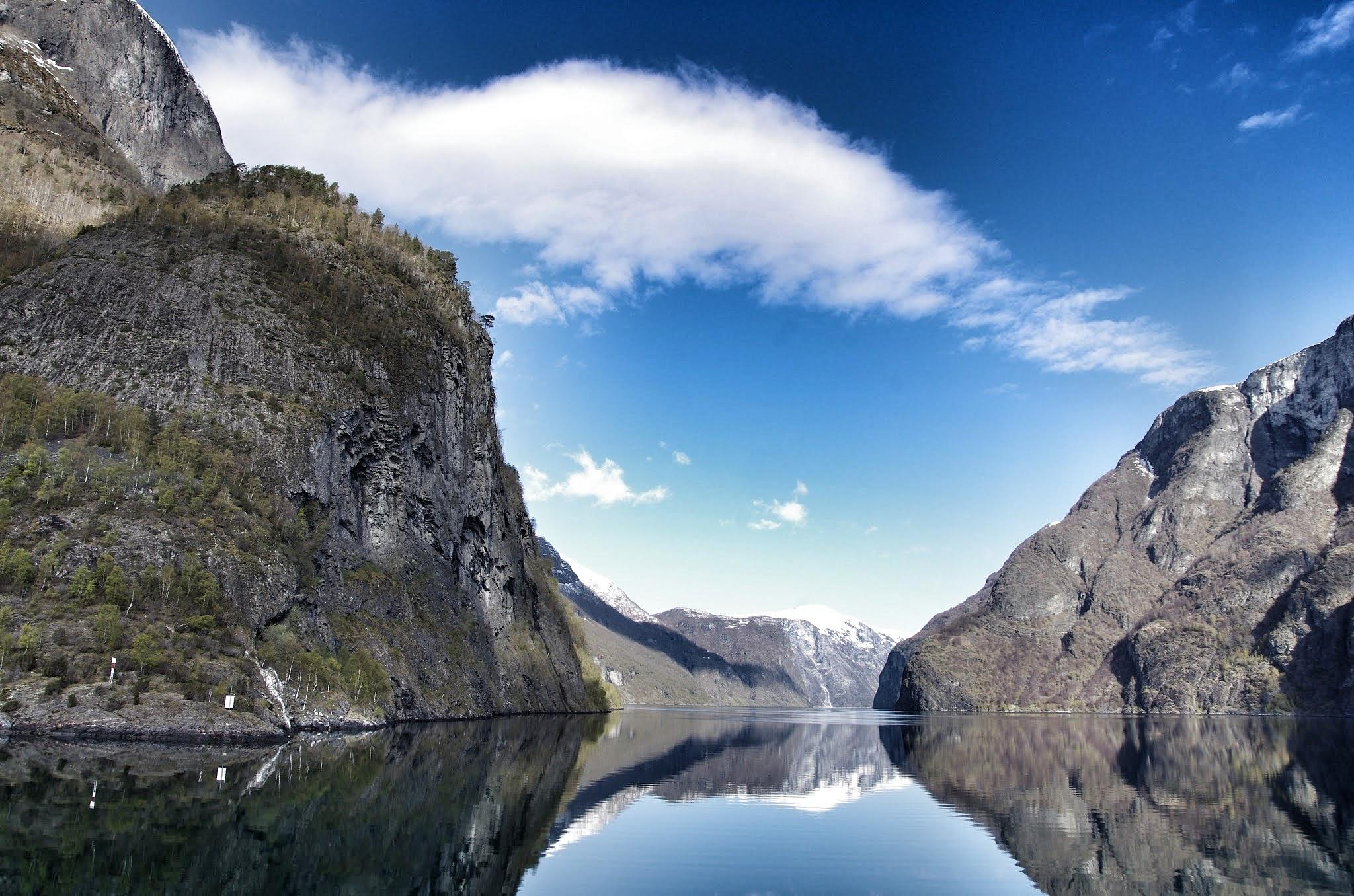 Cloud on fjord by Sjoerd Weiland