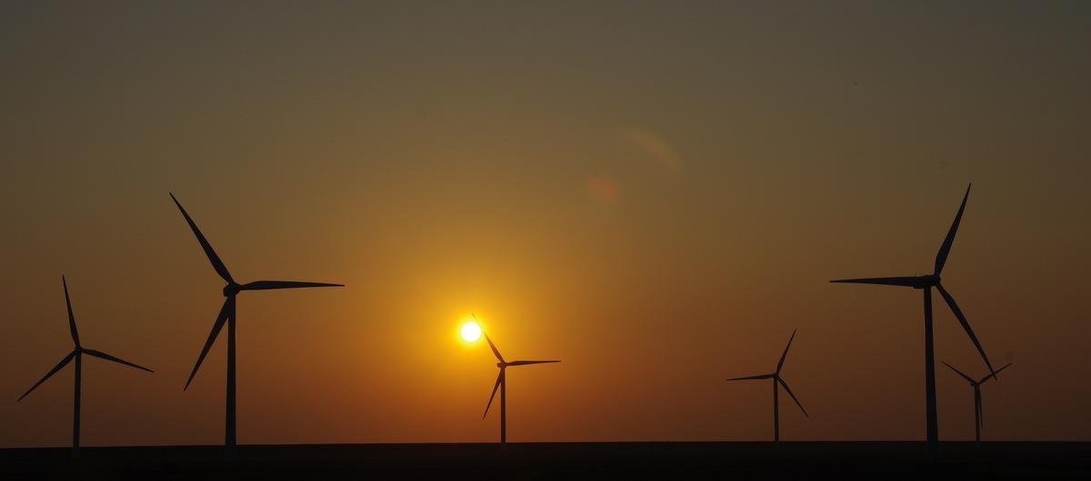Windmills at sunset by Sjoerd Weiland