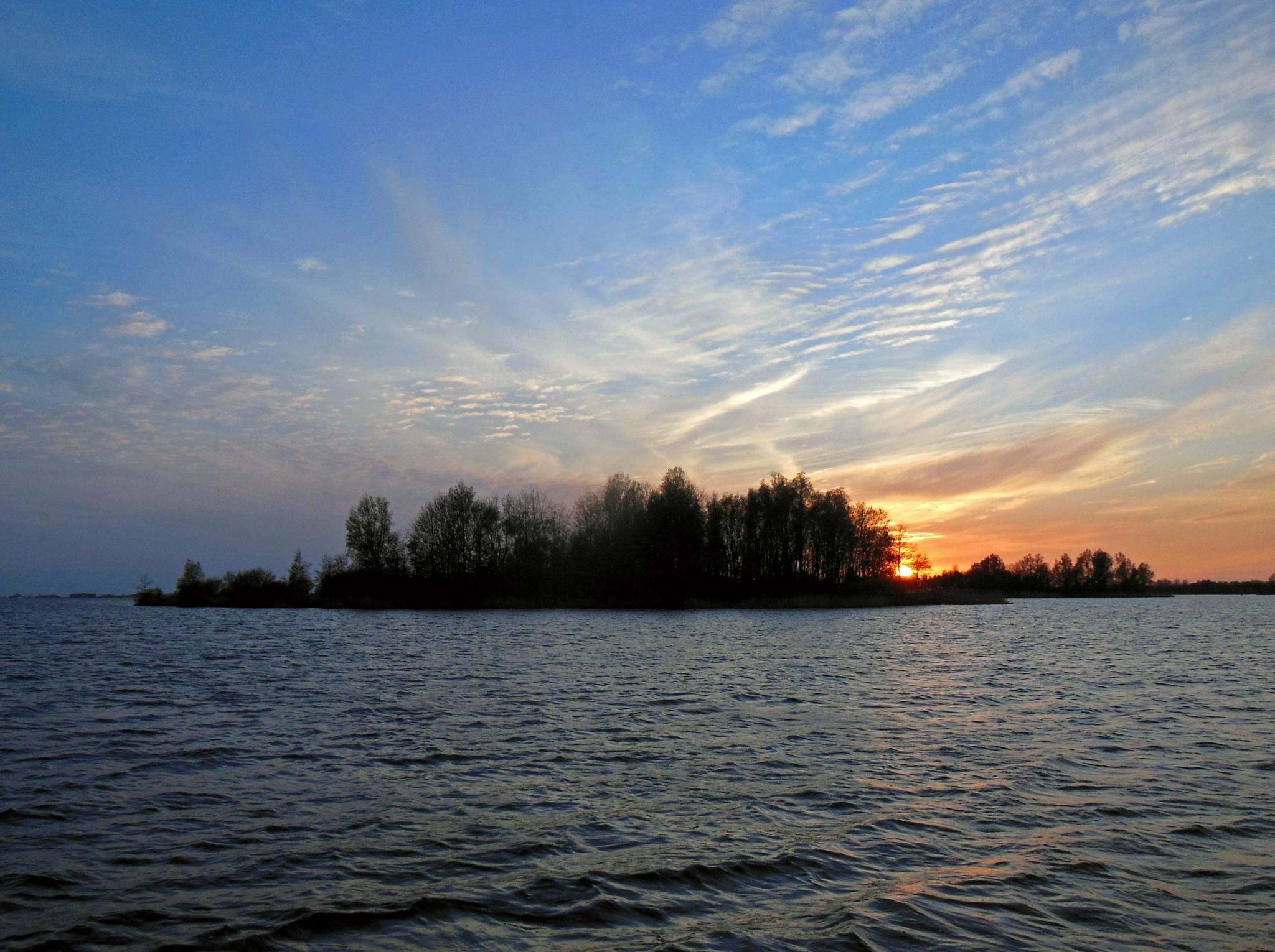 evening sun going down by leendert.terpstra