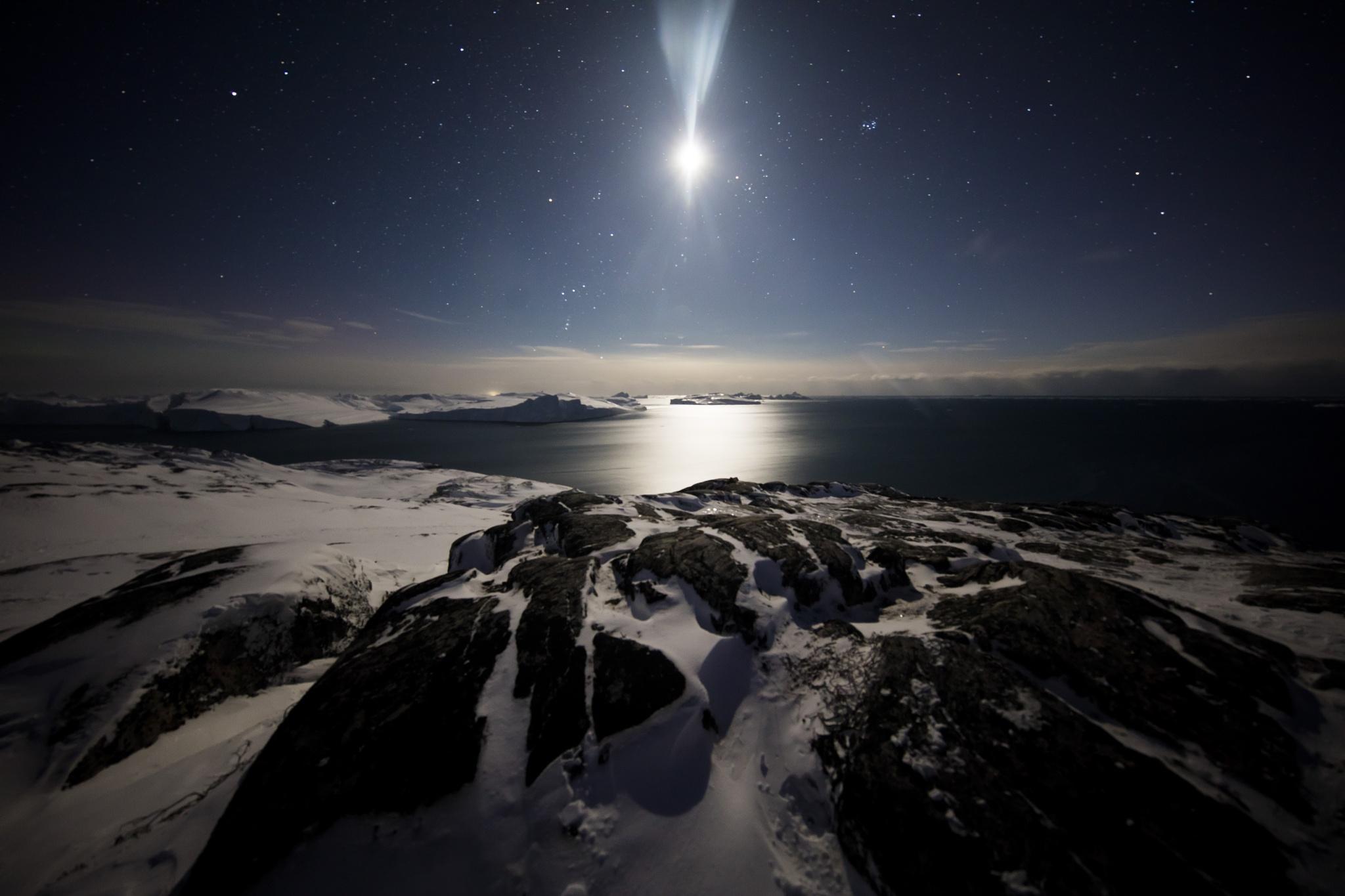 Moonlight over icefjord by sitanvansluis
