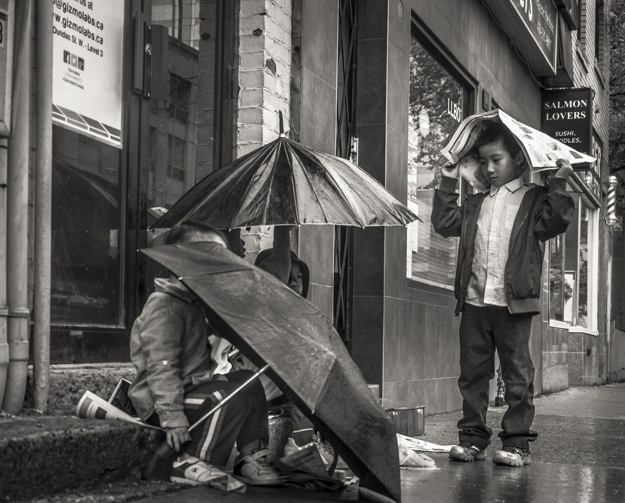 Photo in Street Photography #street photography #b&w #rain #kids
