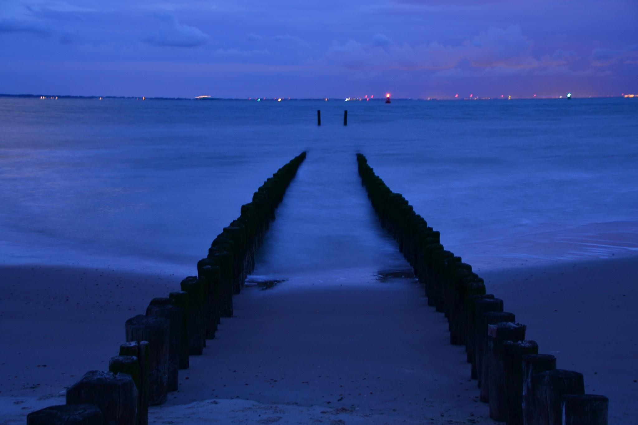 Late at night by the sea entrance to Westerschelde and Port of Antwerp by daan.hoogendijk