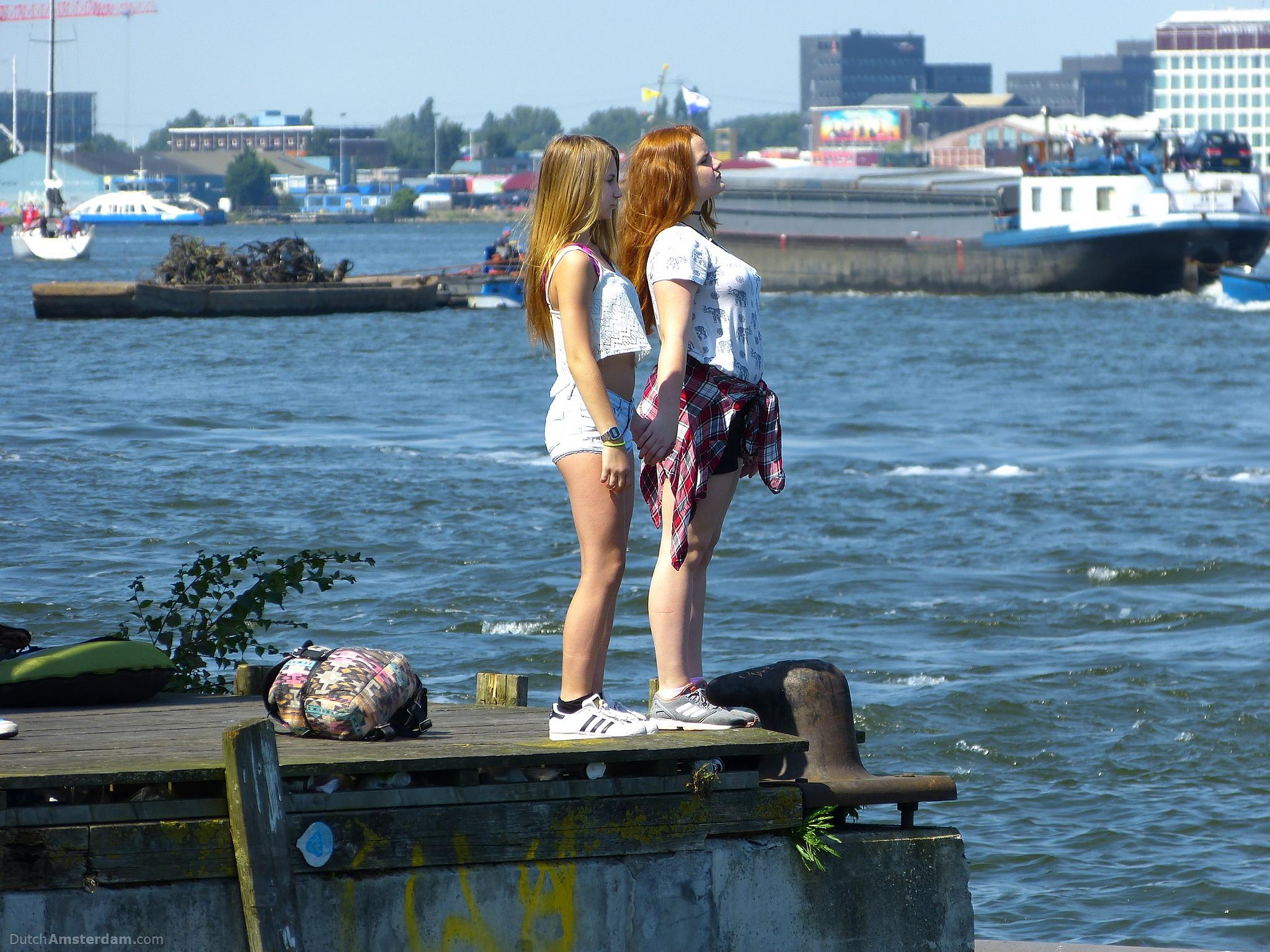 Two girls at the river IJ by DutchAmsterdam