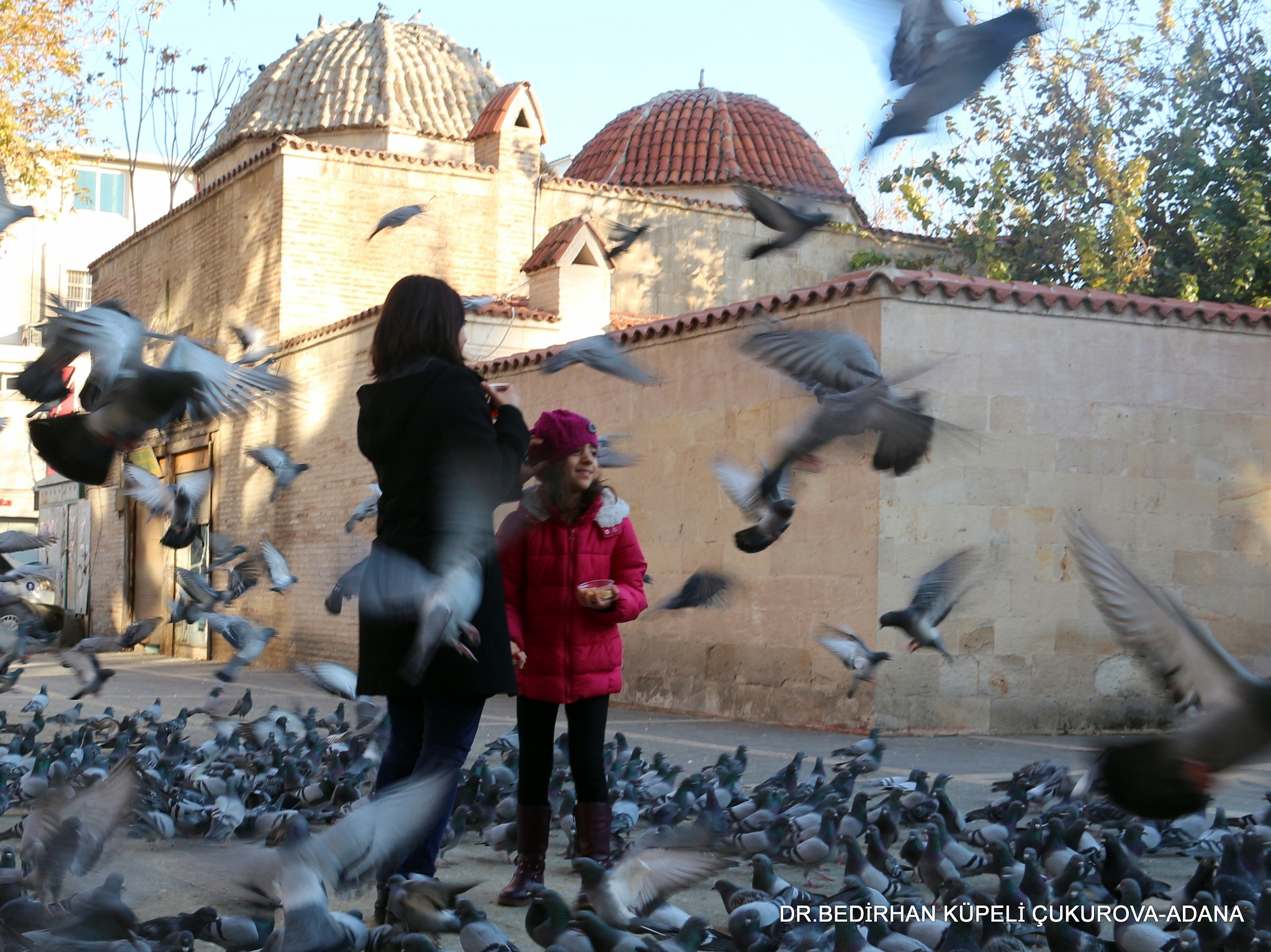 Mother and daughter among the pigeons... by Bedirhan Küpeli