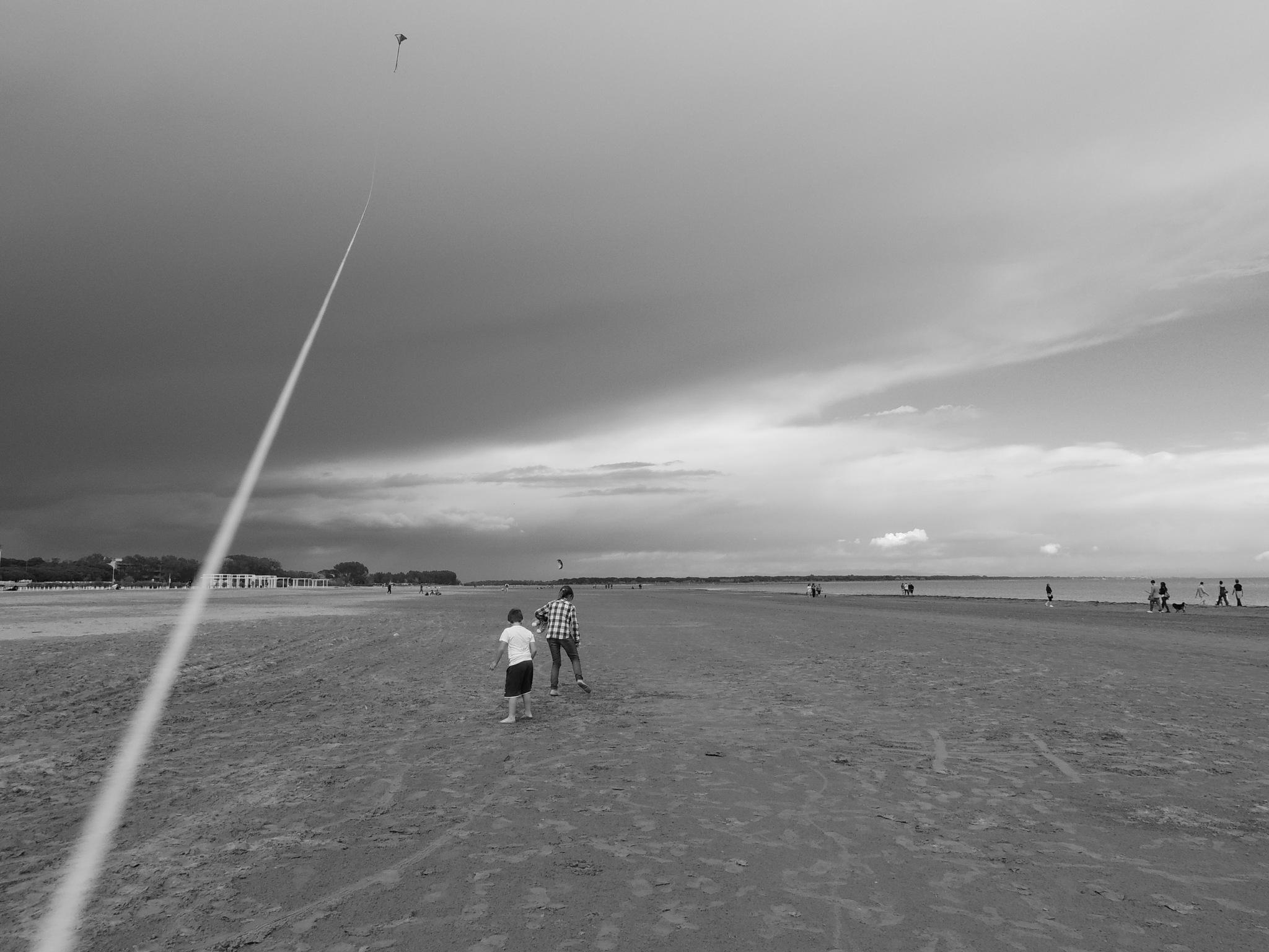Kite in the sky by Damiano Mozzato