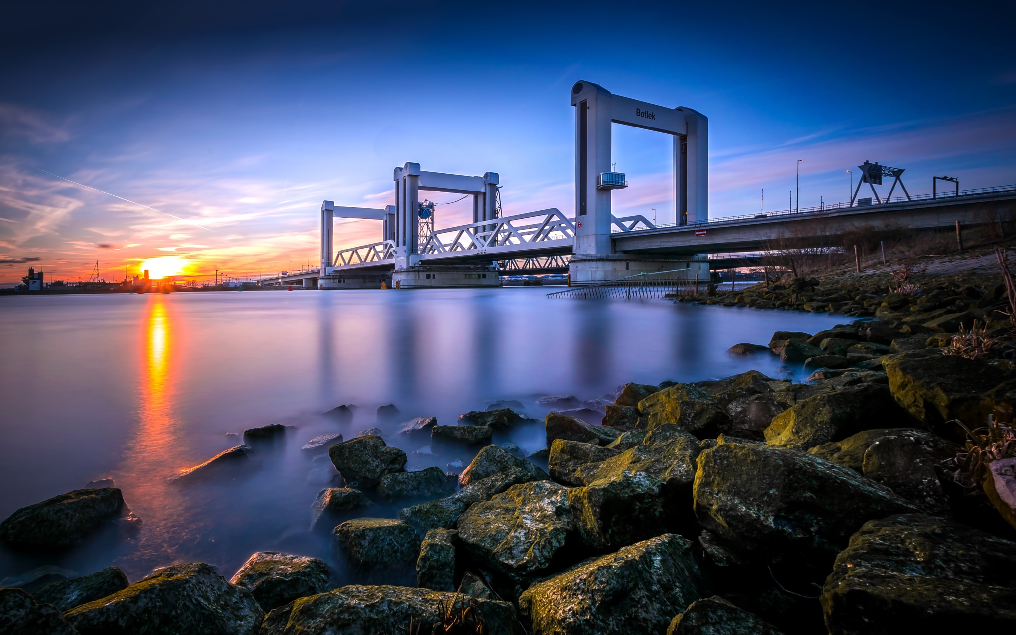 'Botlek' bridge at sunset. by Niels Dam