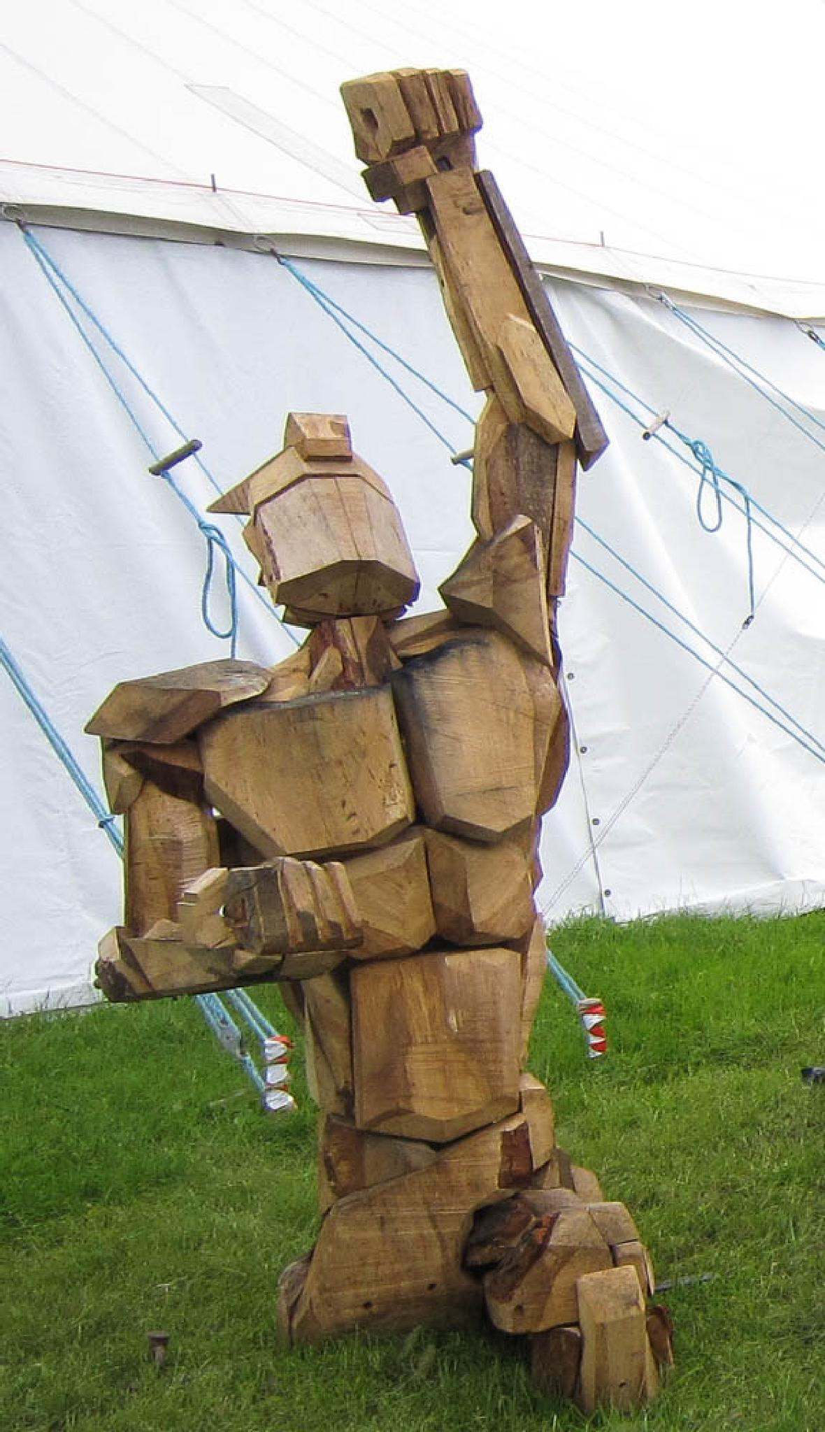 Wooden man sculpture at Art in Action, Waterperry Gardens, nr Oxford by Scottie
