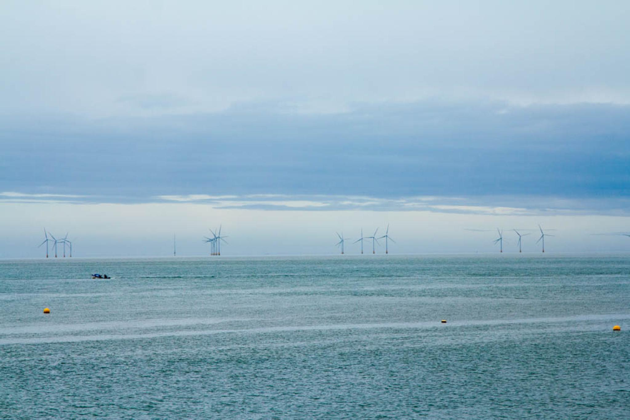 Windfarm off Whitstable beach Kent by Scottie