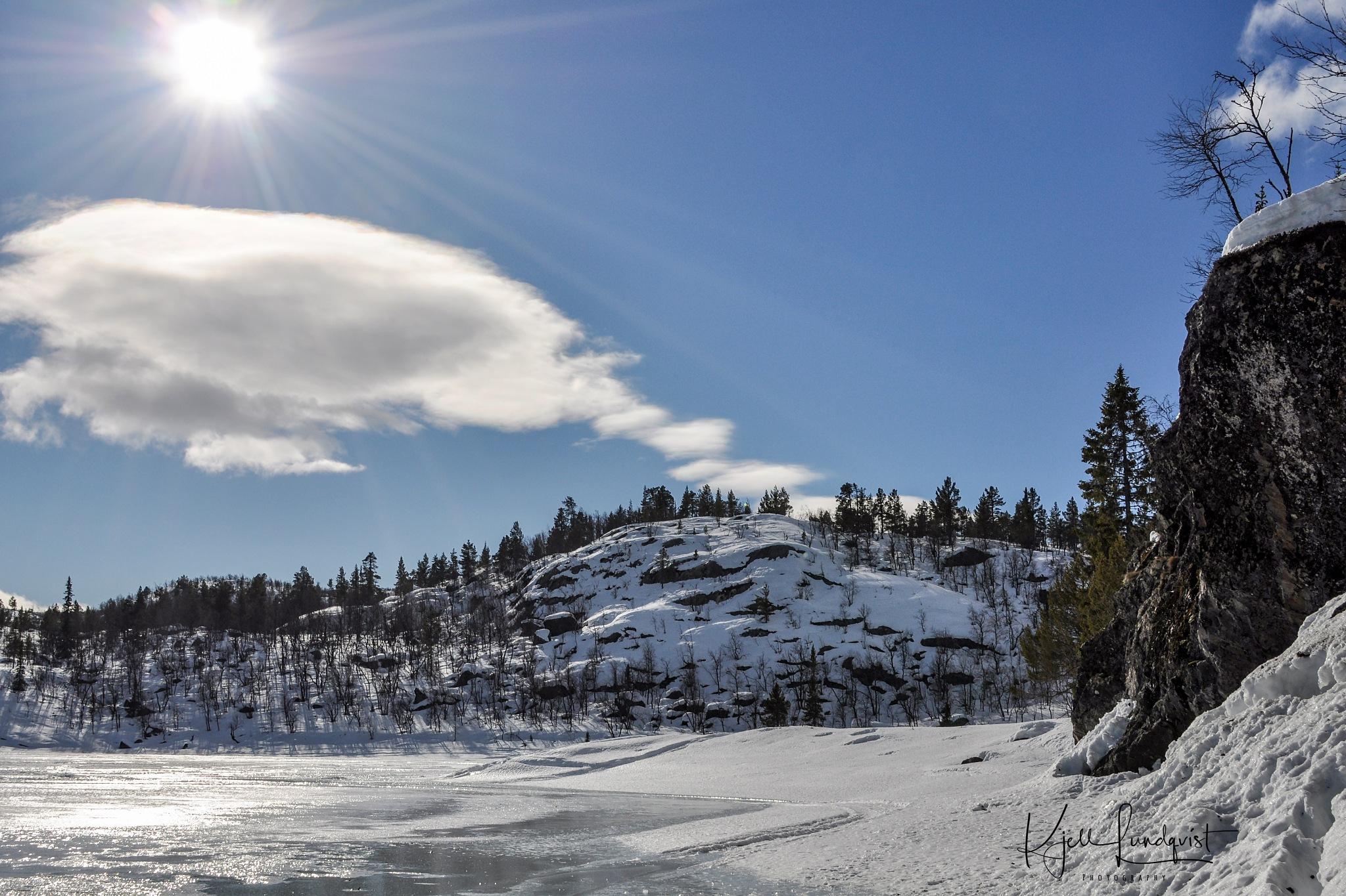 Sun, cloud, ice and snow by Kjell Lundqvist