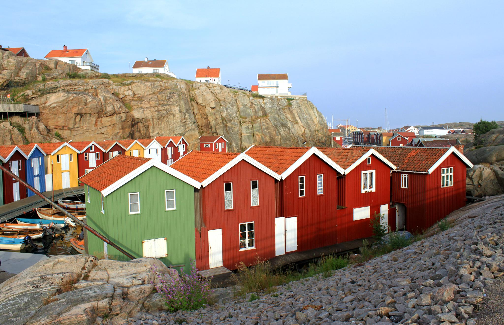 Colourful boathouses by fotofredrica