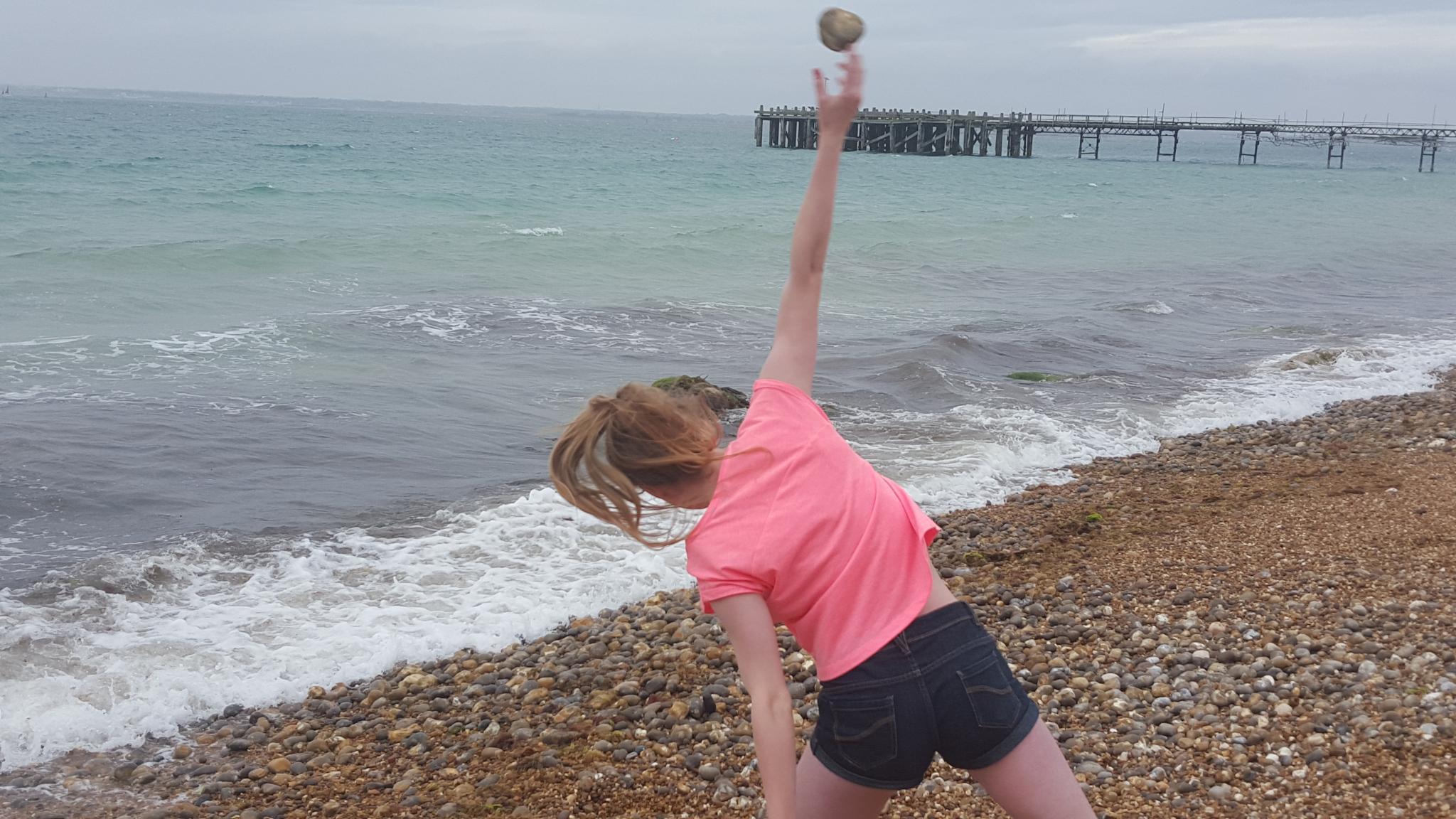 stone throwing at a beach by Jan.ohnokt
