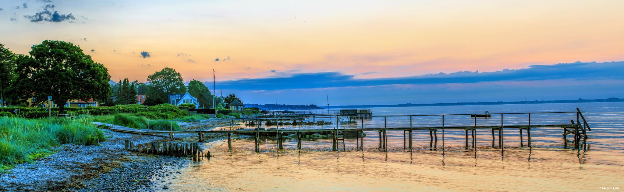 Sunrise over Oeresund by M. Loeth