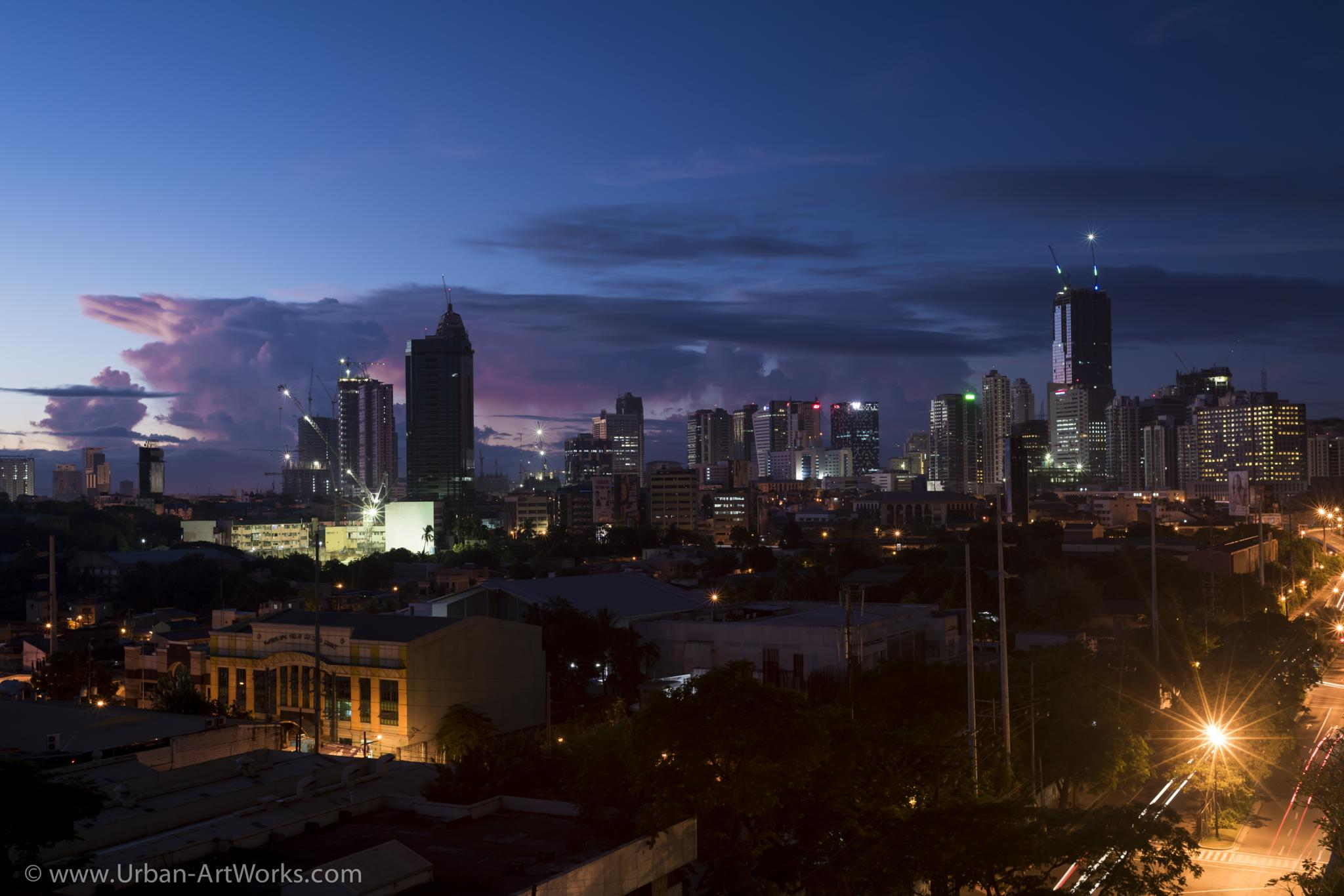 Sunrise in Manila by Ole Morten Eyra