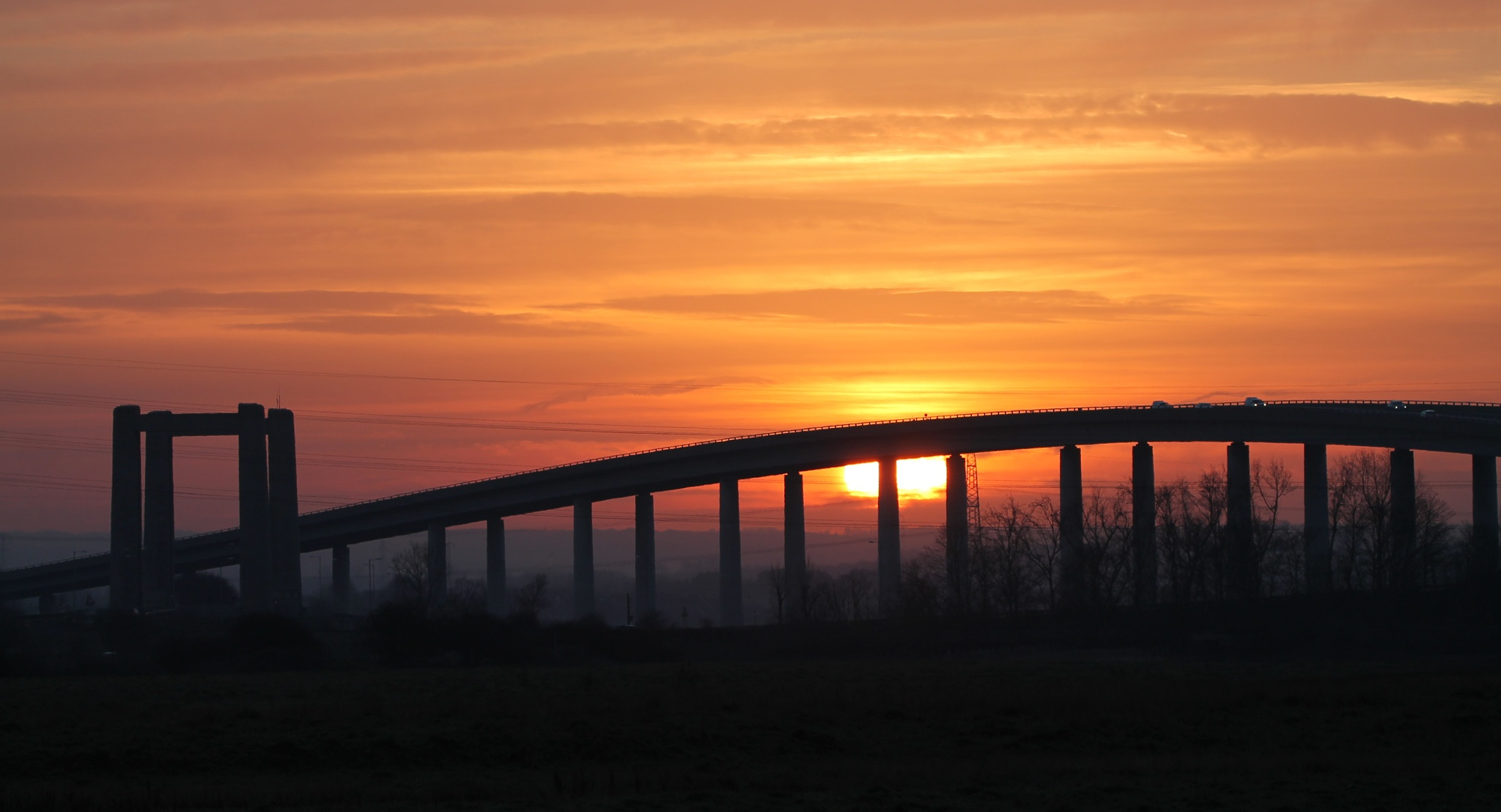 Sunset over Sheppey Bridge by Dave Griffin Photography.