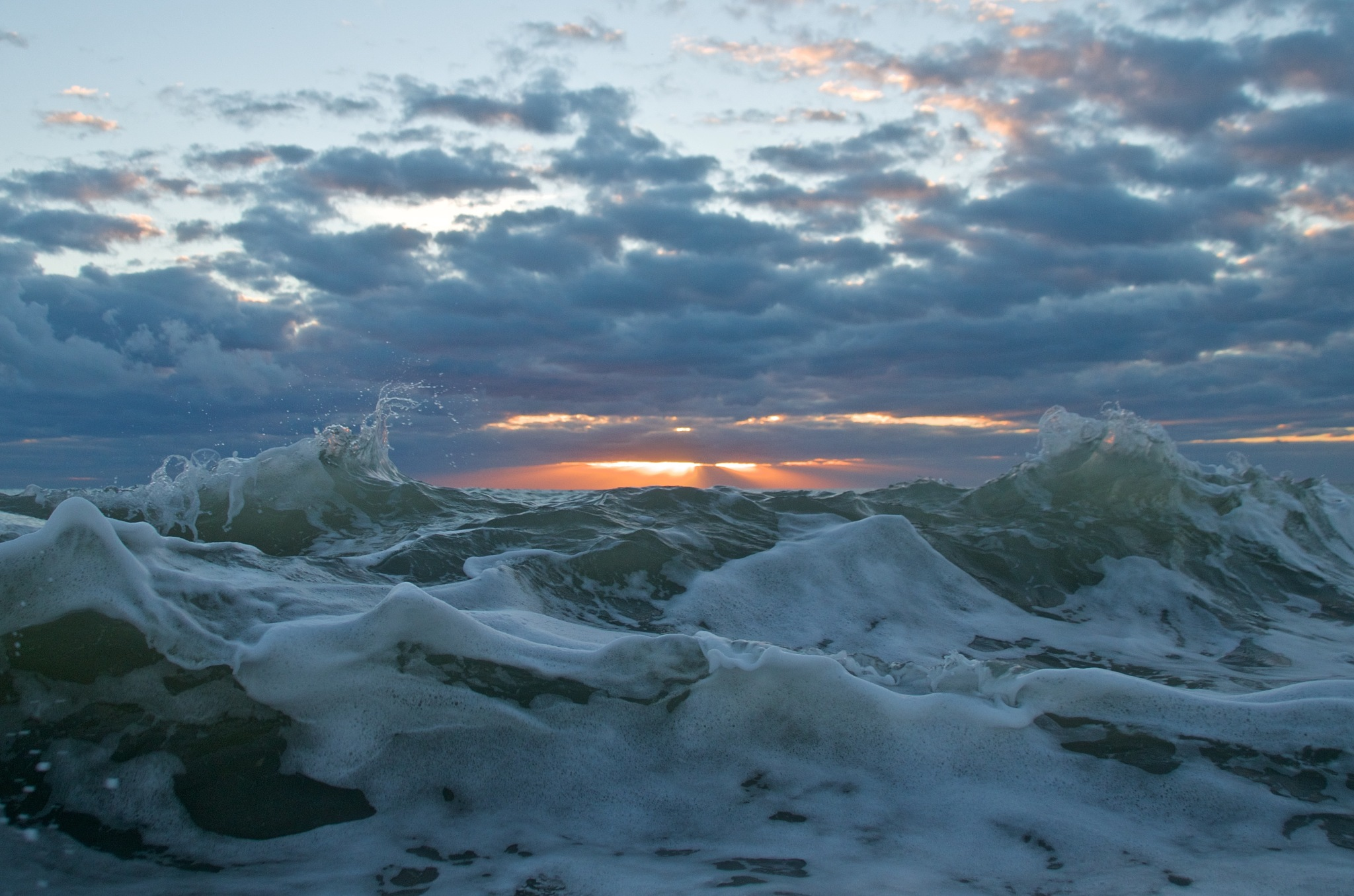Sunrise with Mountain Looking Waves by tracey.kurilla