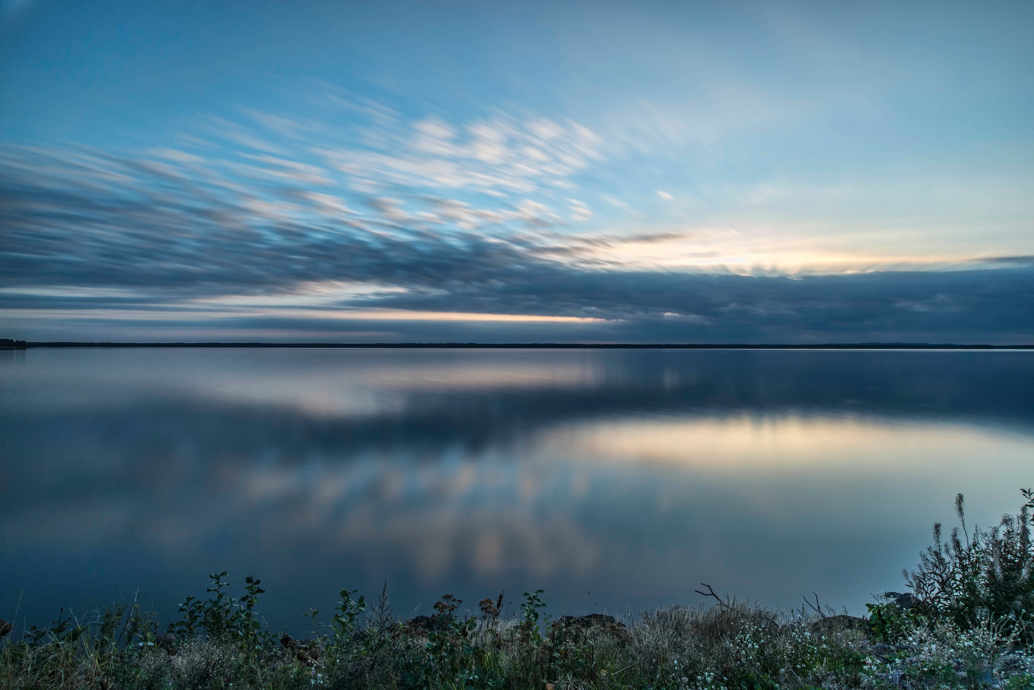 Sunset behind clouds by Jörgen Lindgren