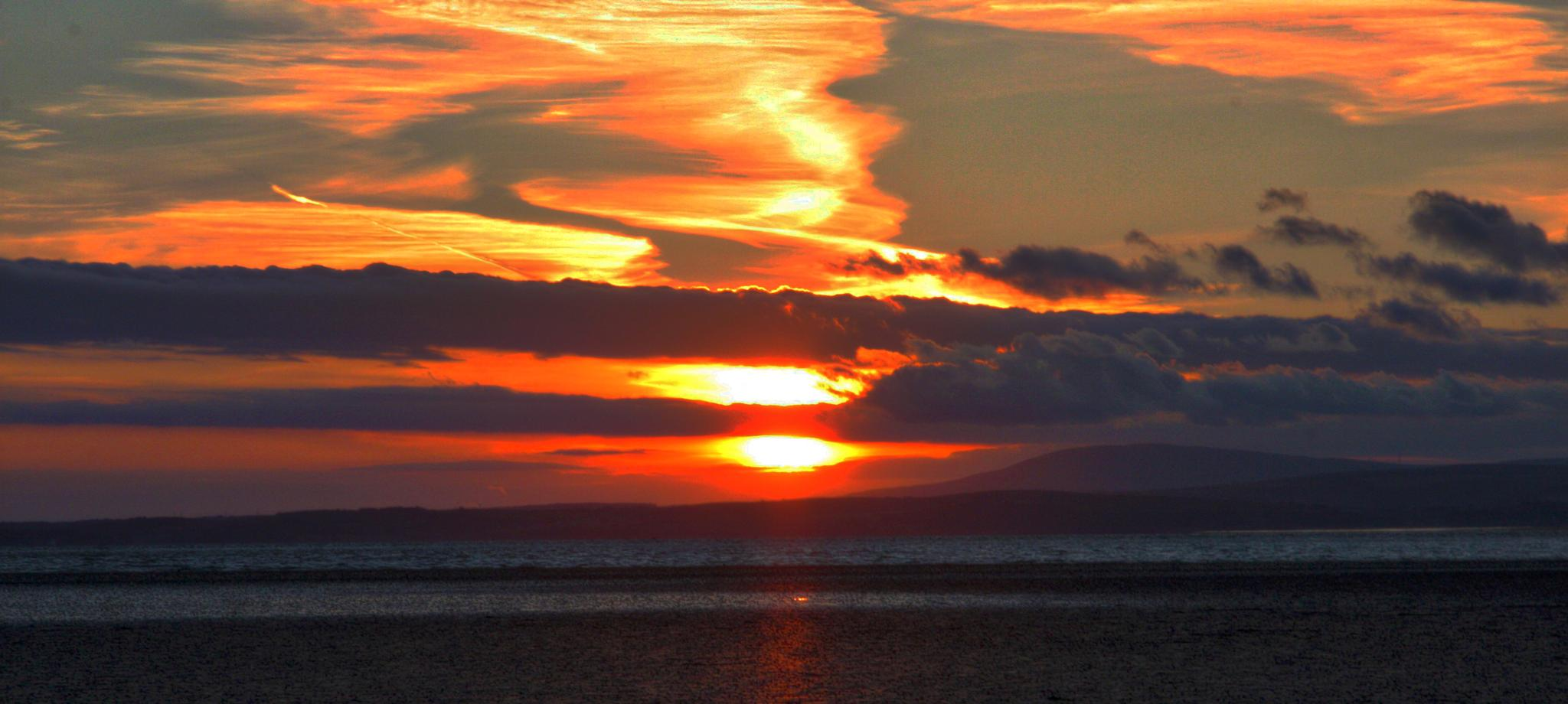 sunset over morecambe by steveworrll