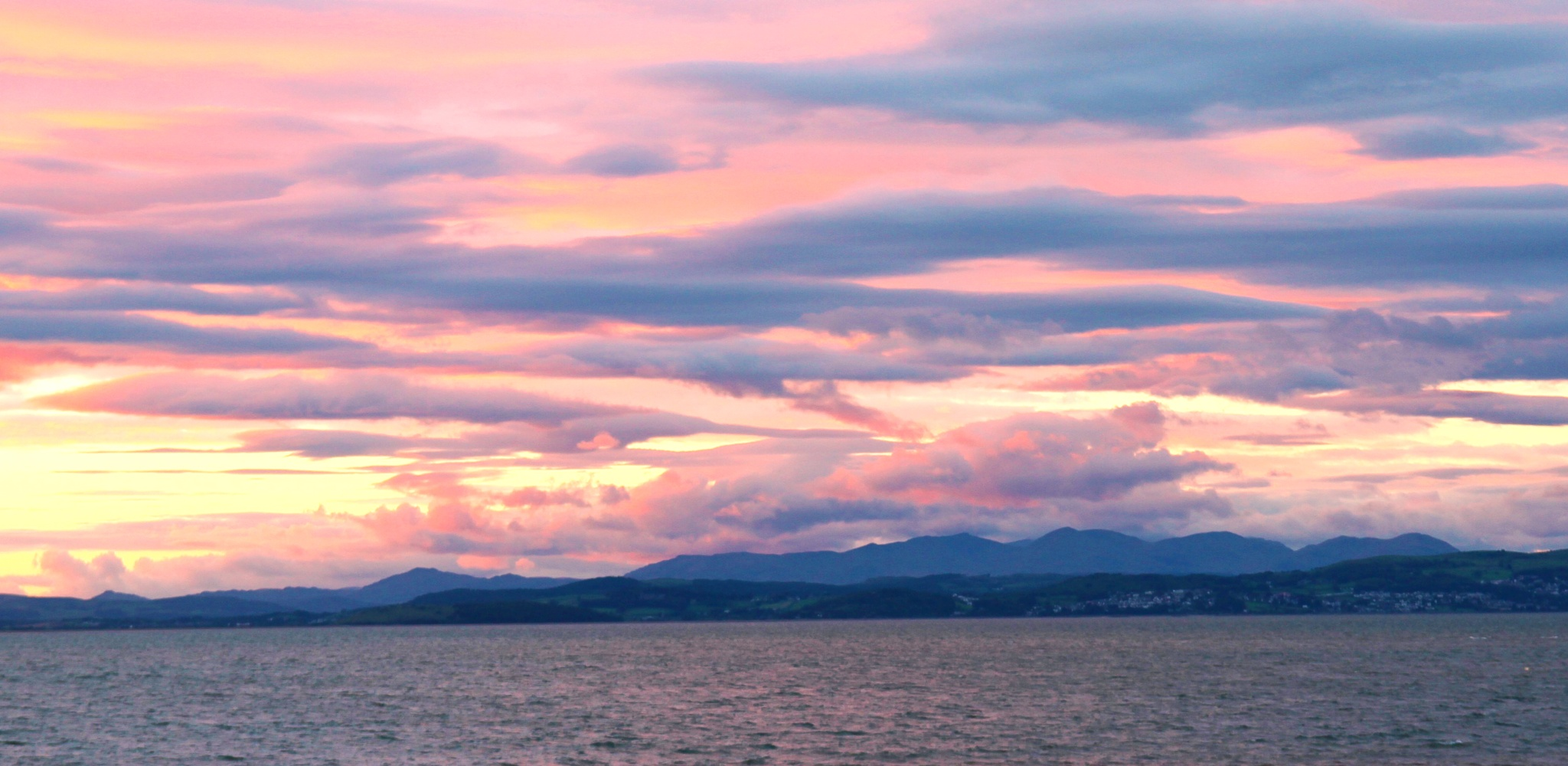 sunset sky over morecambe bay by steveworrll