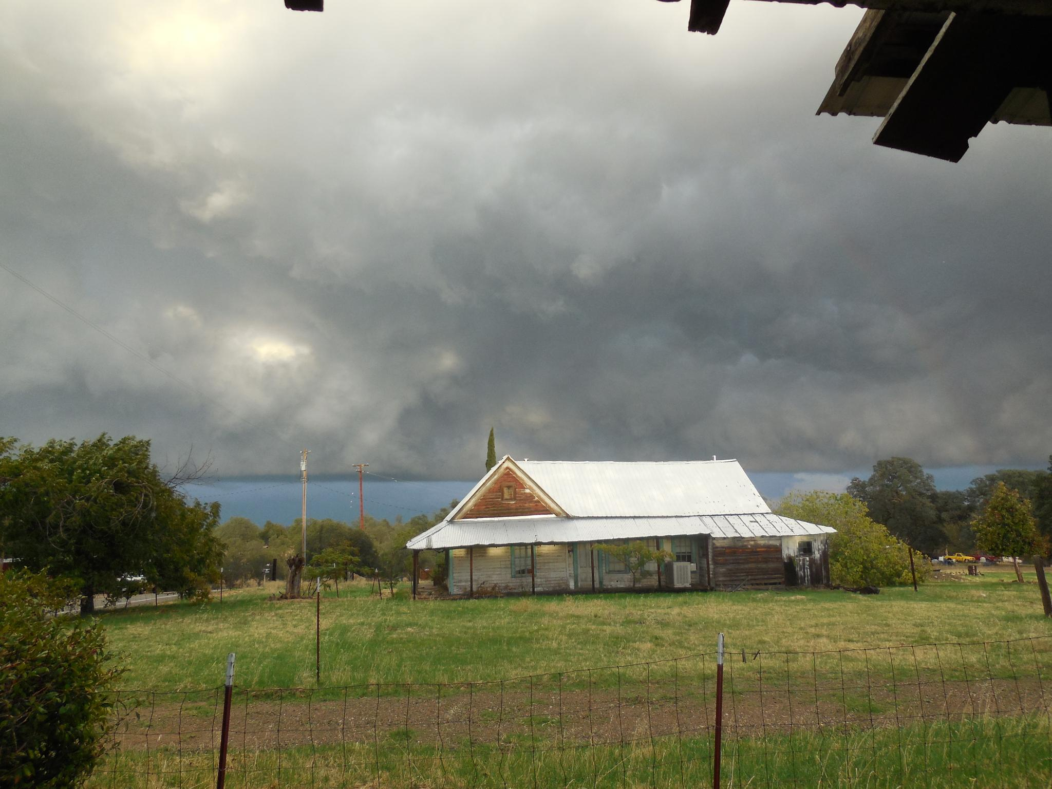 Storm over abandoned house by Debbie Galvez