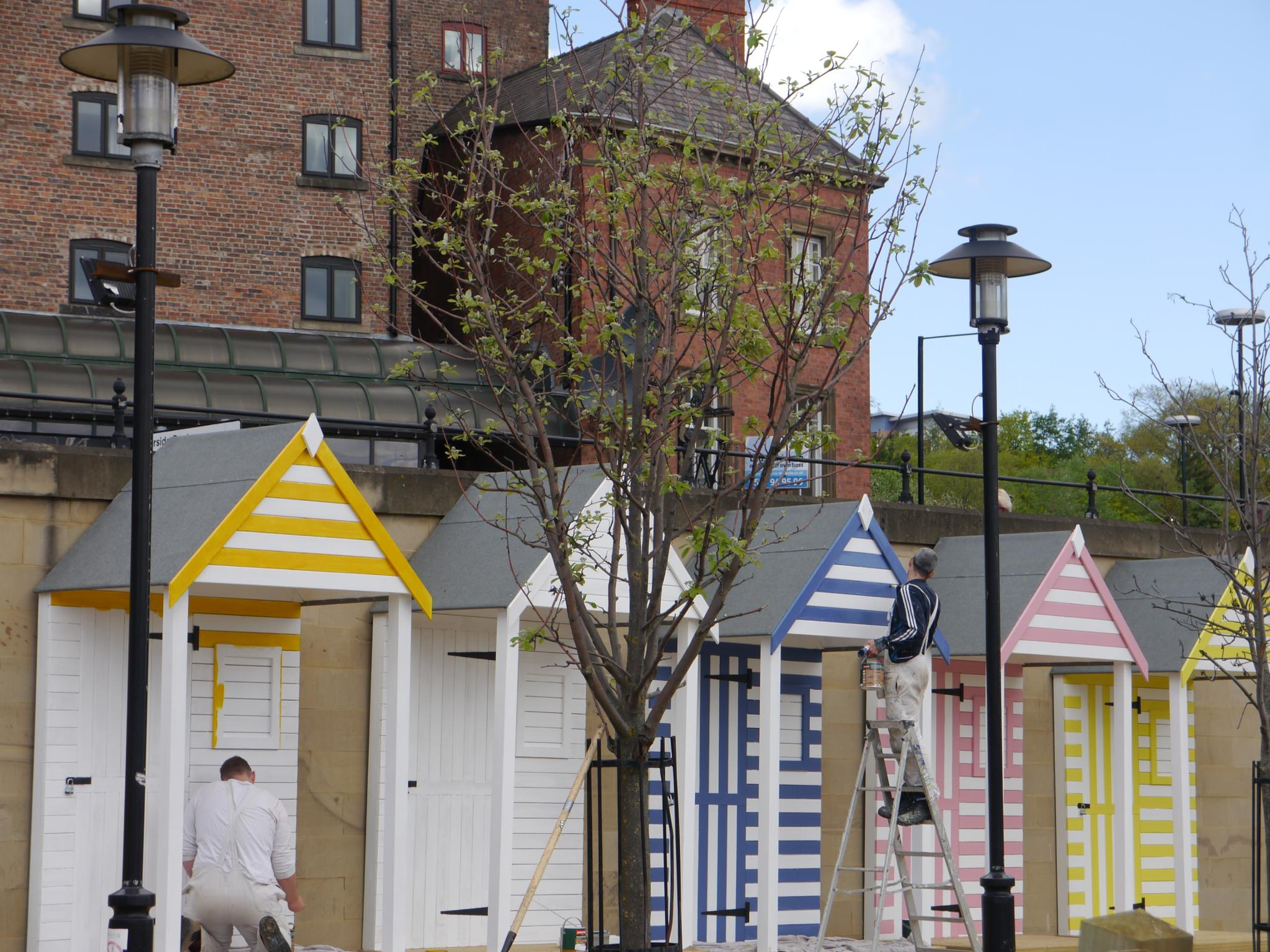 Beach huts getting painted.....Newcastle Quayside by Darren Turner