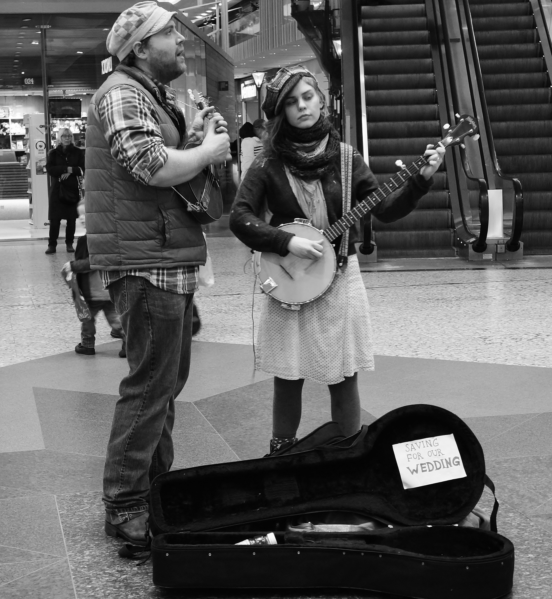 "Street musicians - ""saving for their wedding"" - in B/W by rolf persson"
