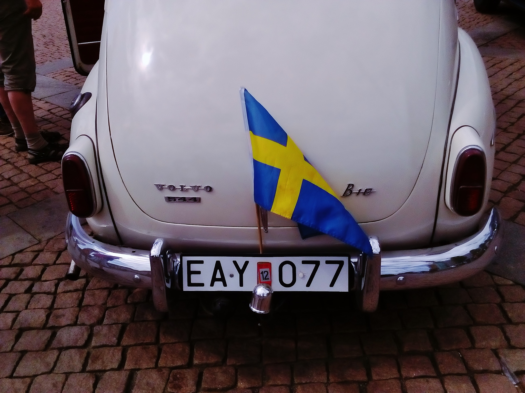 Swedish national day 6/6 - Classic vintage Volvo 444 and swedish flag by rolf persson