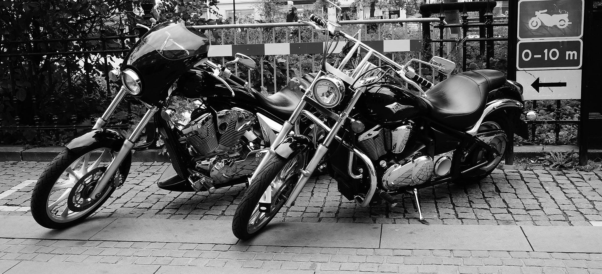 Two classic motor bikes - in blackandwhite by rolf persson