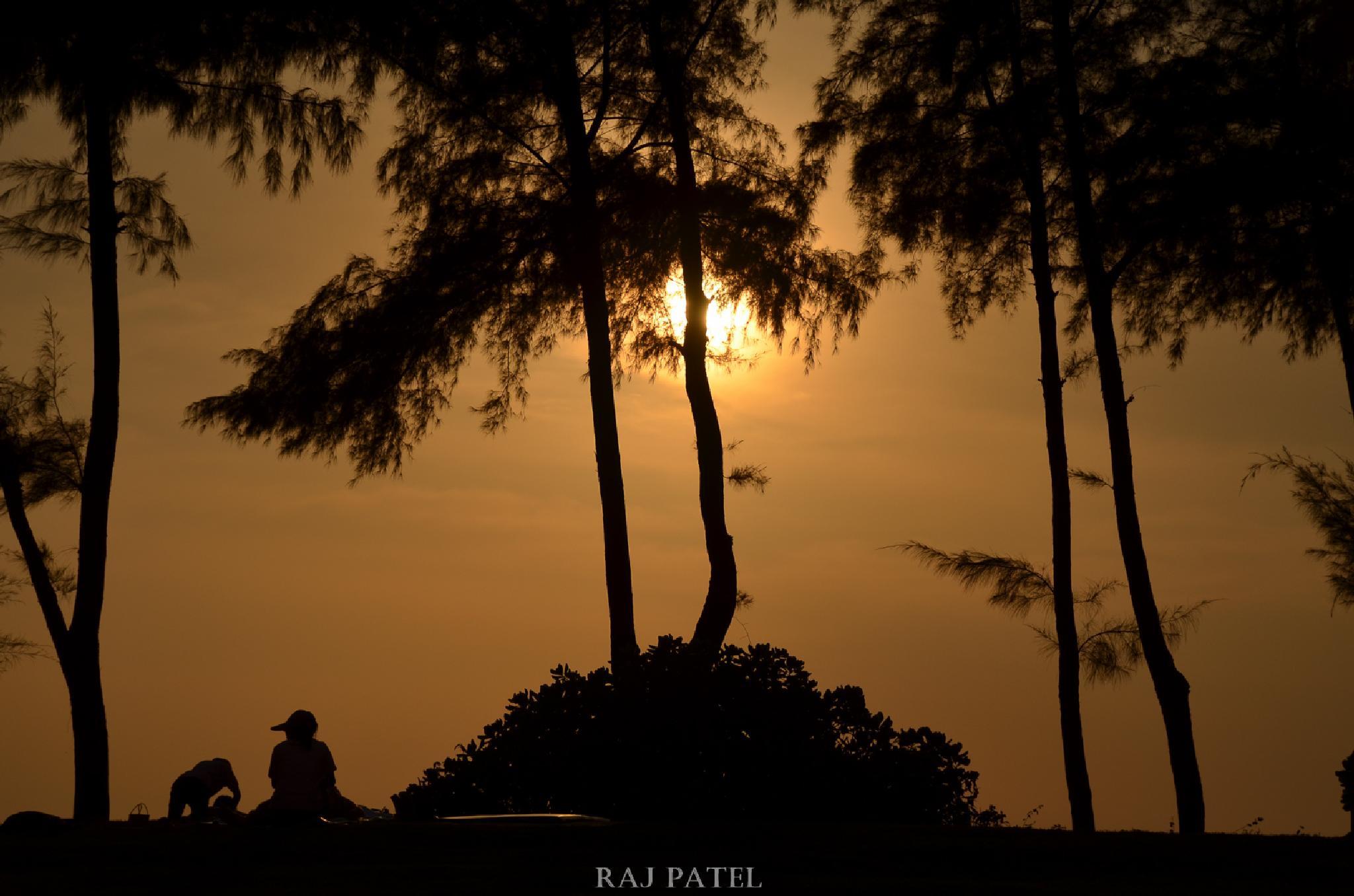 Silhouette of having a massage on Phuket beach by Raj Patel