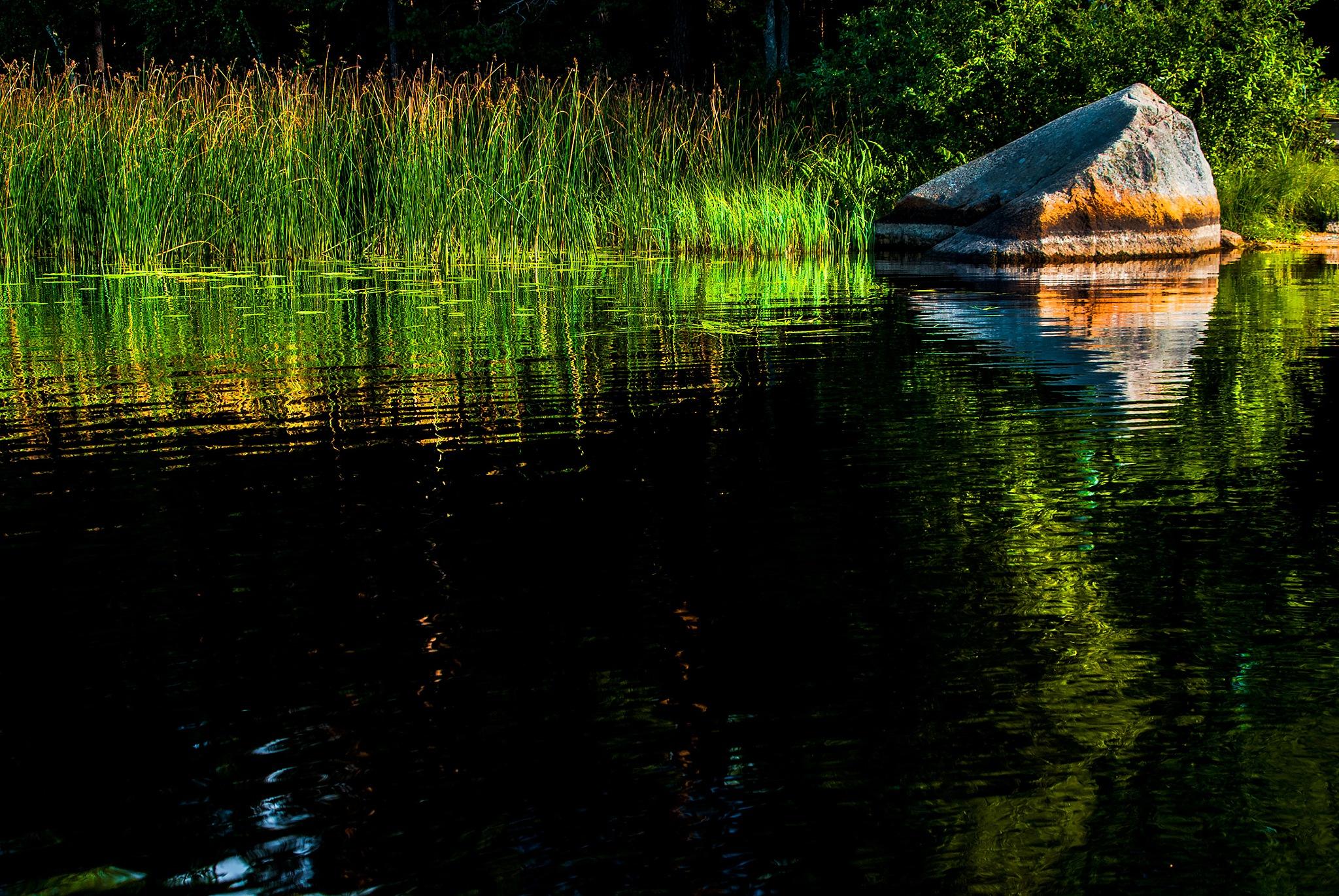 Deep dark lake and some light. by MaritaToftgard