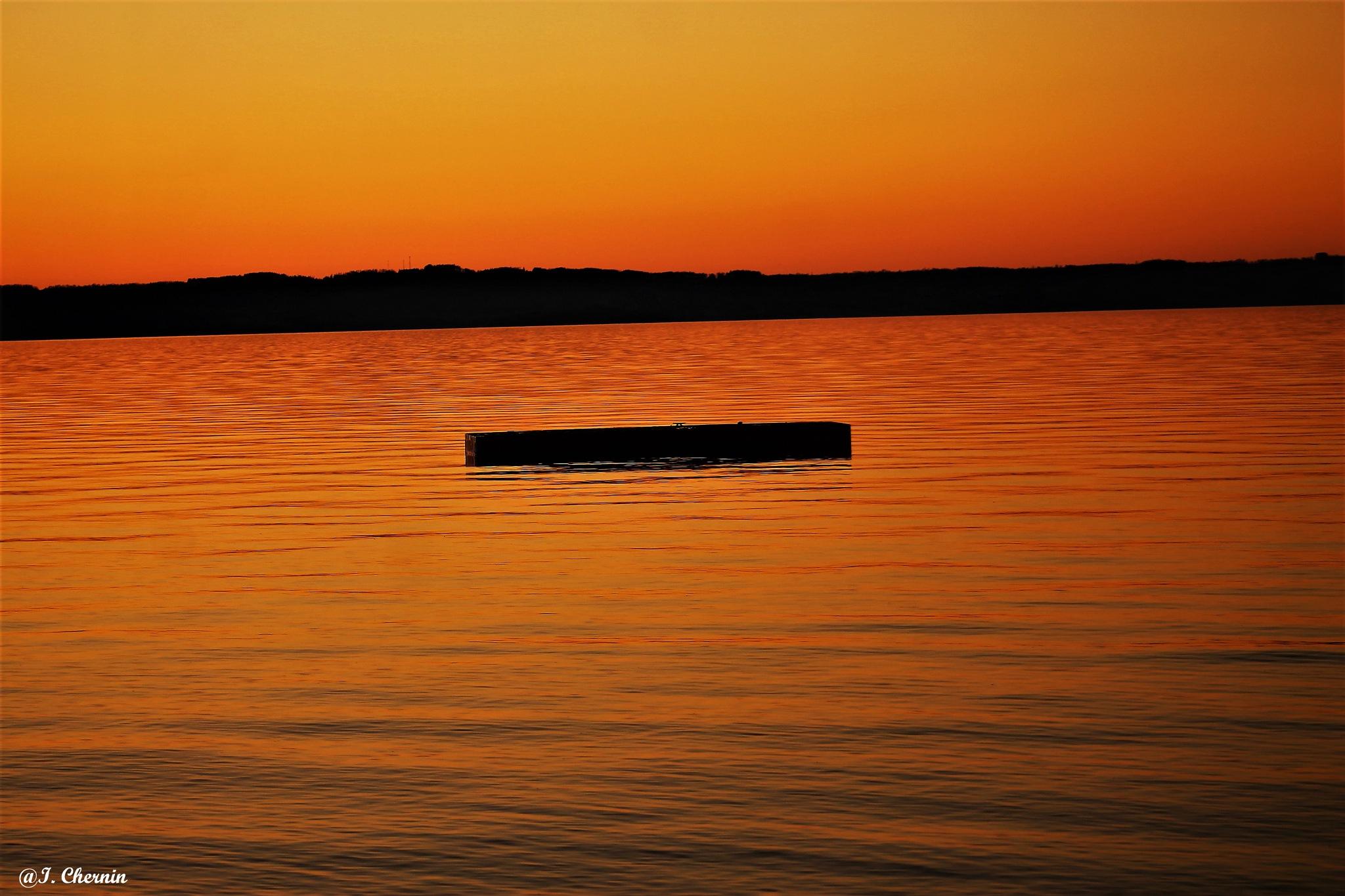 calm at sunset by ichernin