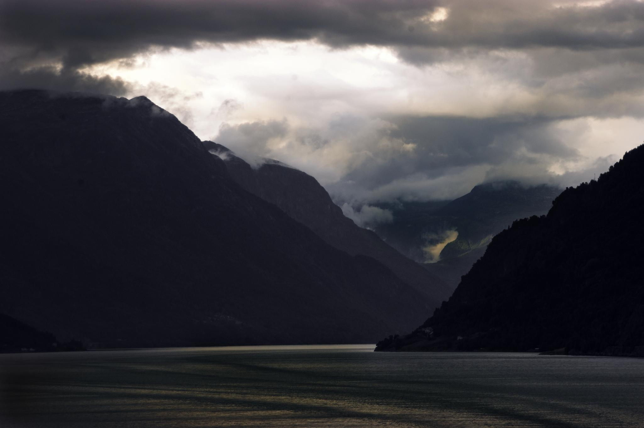 Dark Clouds over the Fjord by Rupert.Johnson