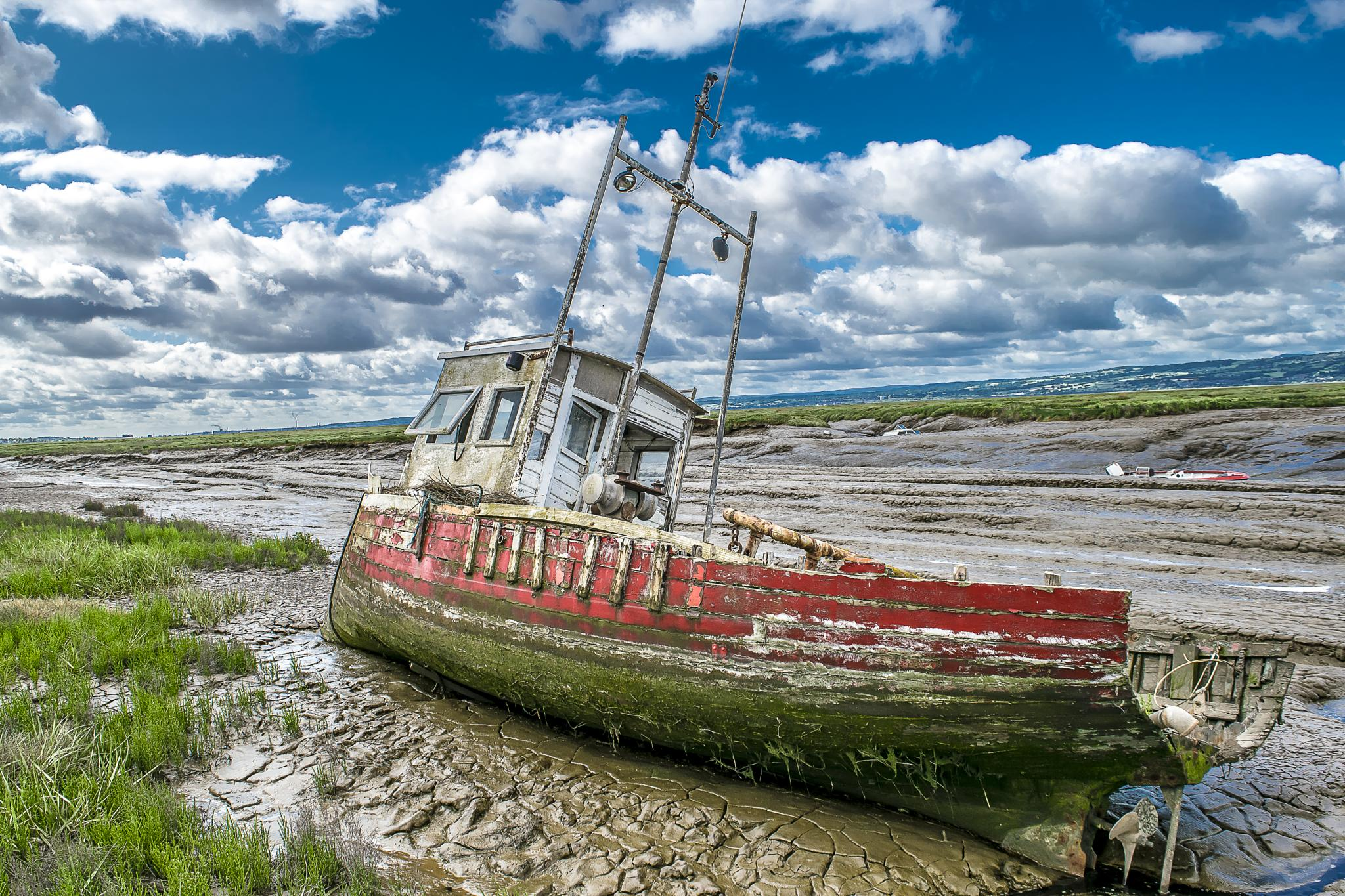 Photo in Landscape #low tide #dry dock #boats #ships #water #sea #mud #mud flats #red boat #samphire #ship wreck #wrecked #abandoned #moss #prop shaft #heswall #wirral